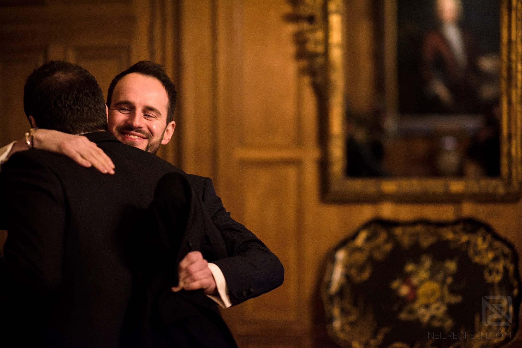 guest hugging groom at Arley Hall wedding