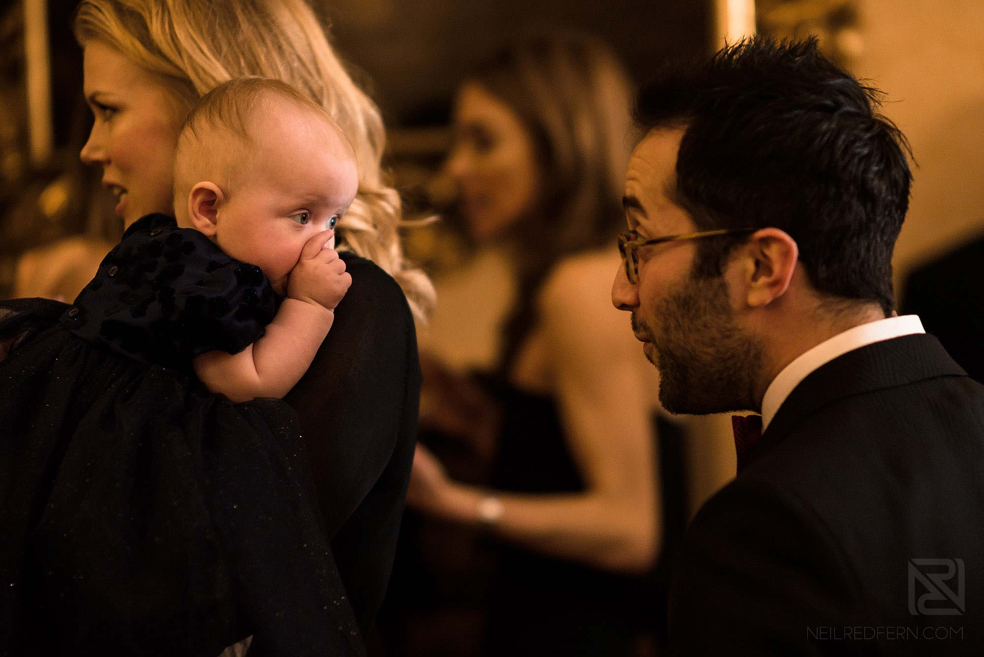 wedding guest playing with baby