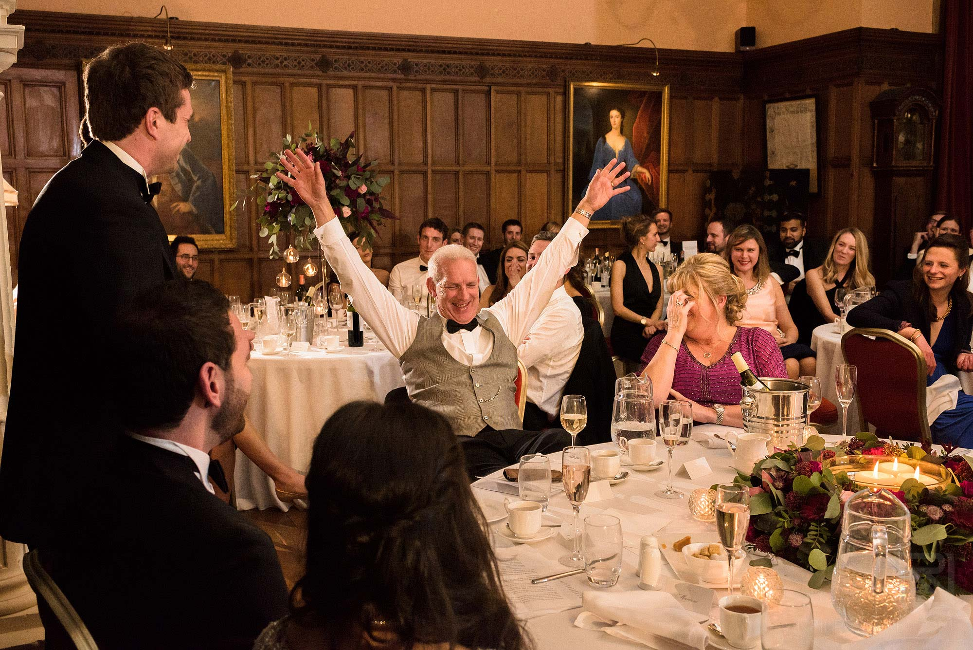 father of groom laughing during wedding speeches