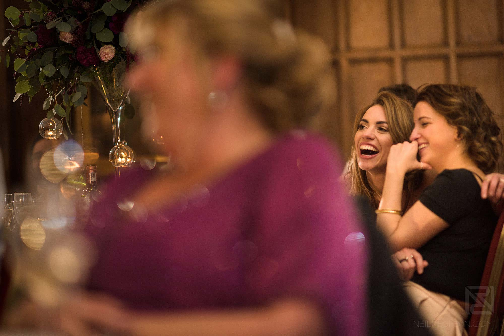 guests laughing during wedding breakfast