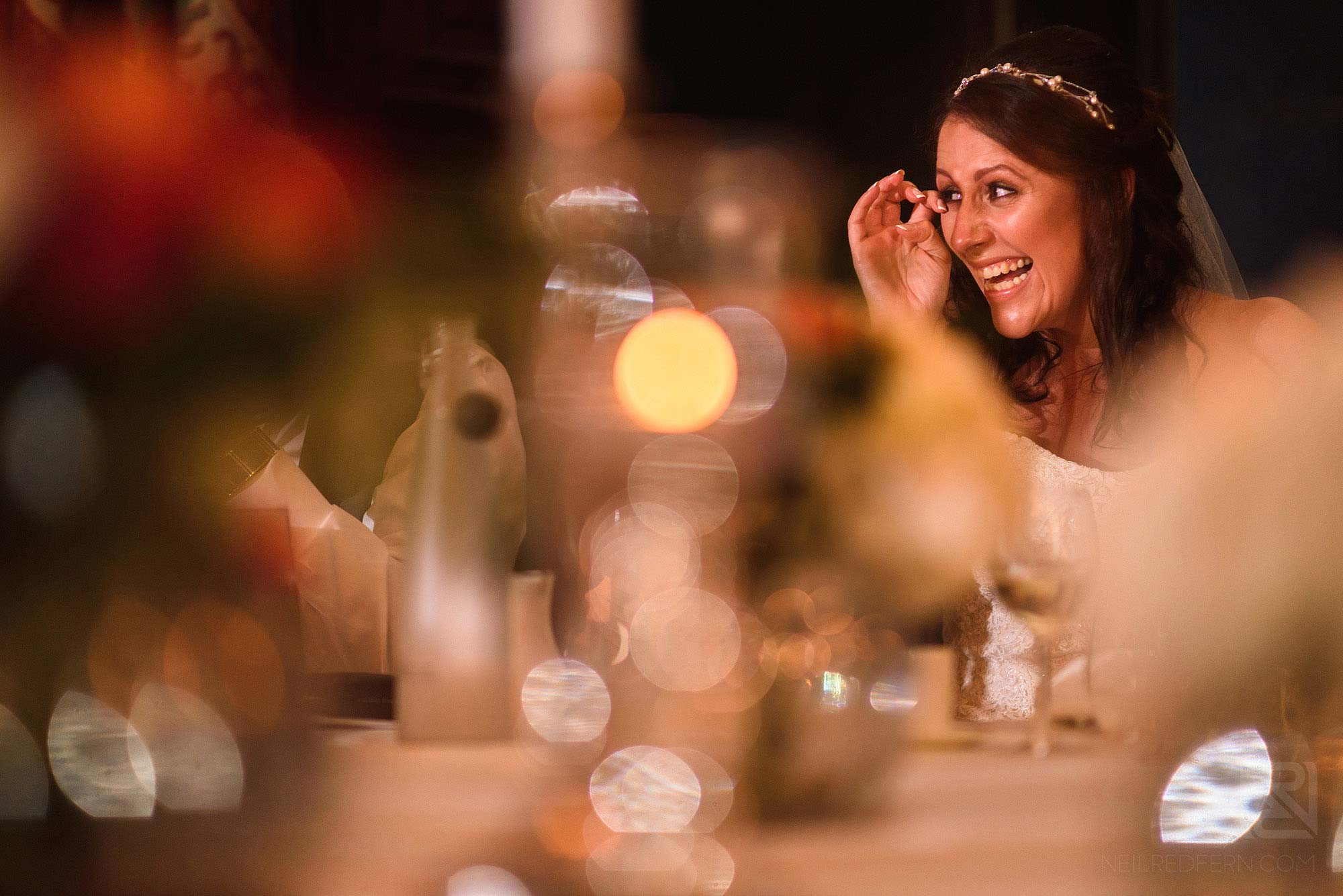 bride laughing during wedding speeches at Knowsley Hall