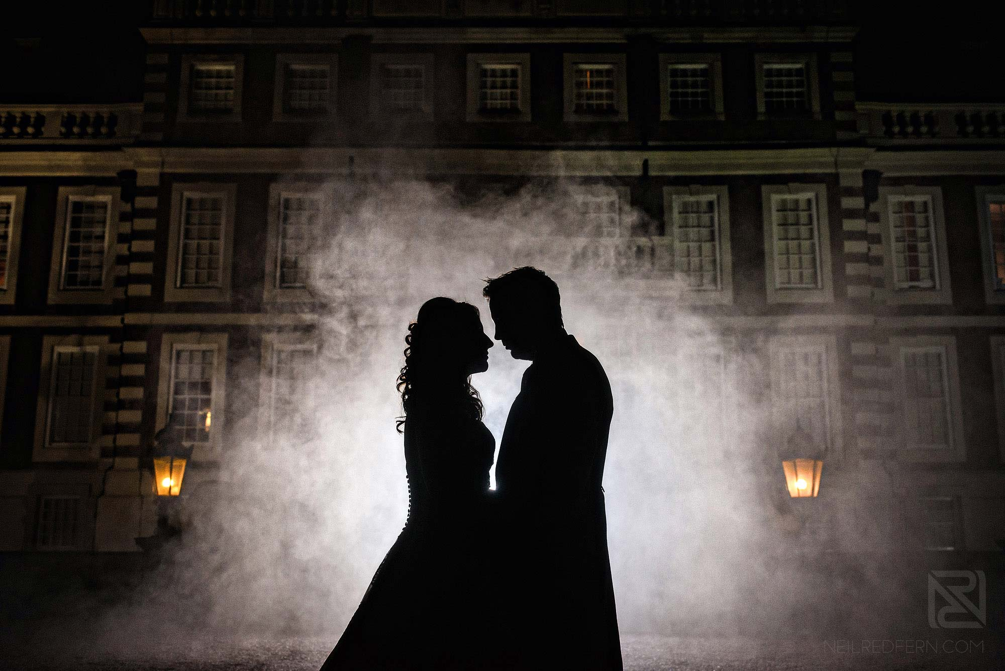 creative silhouette photograph of bride and groom outside Knowsley Hall