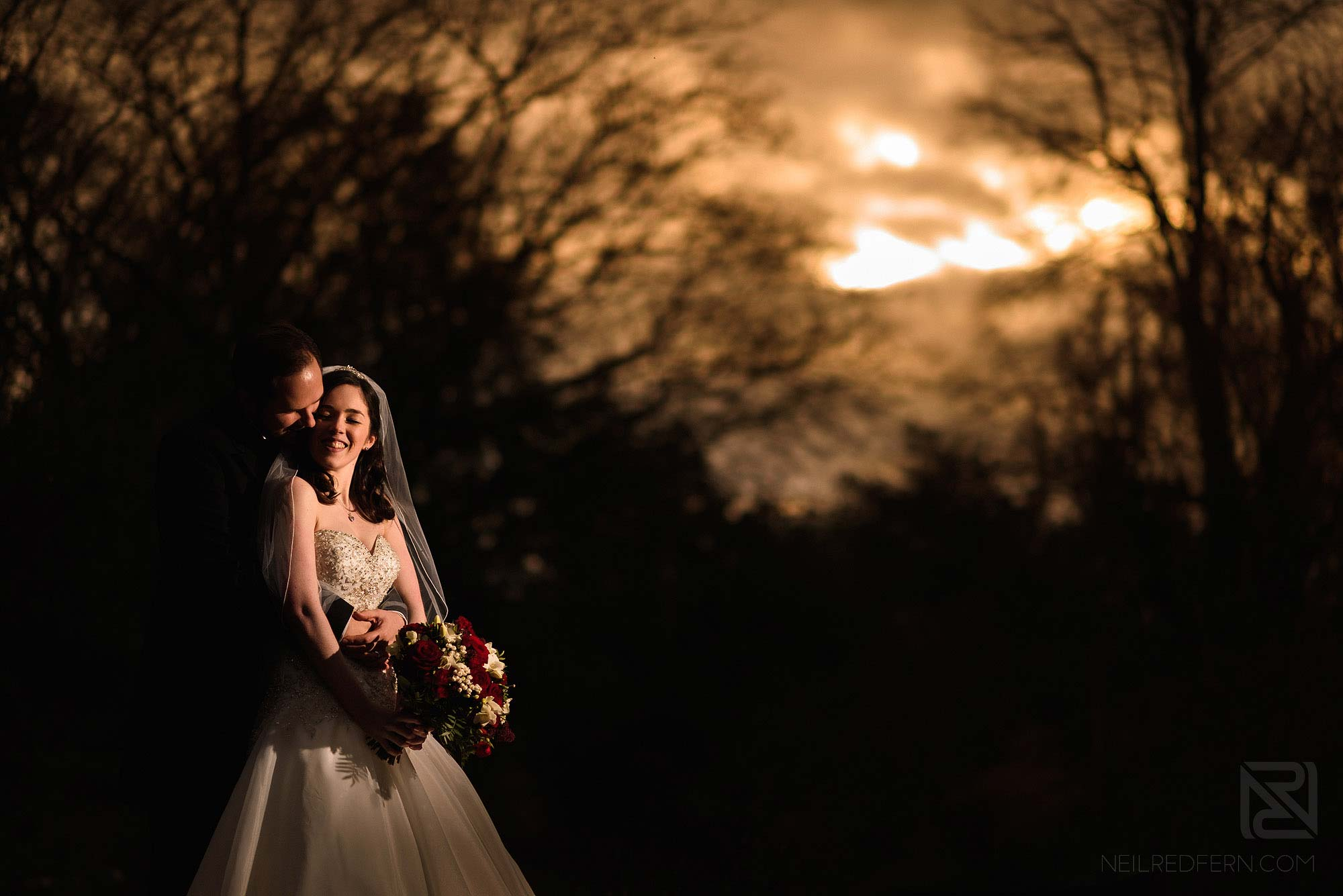 bride and groom portrait at sunset in winter