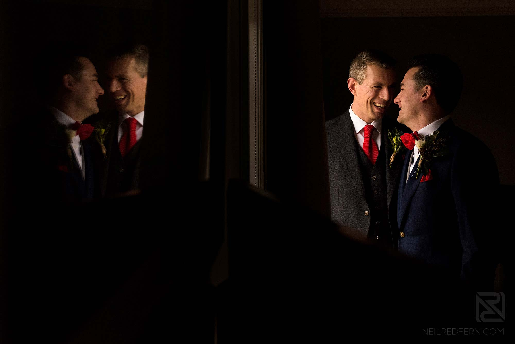 romantic photograph of two grooms at civil partnership wedding