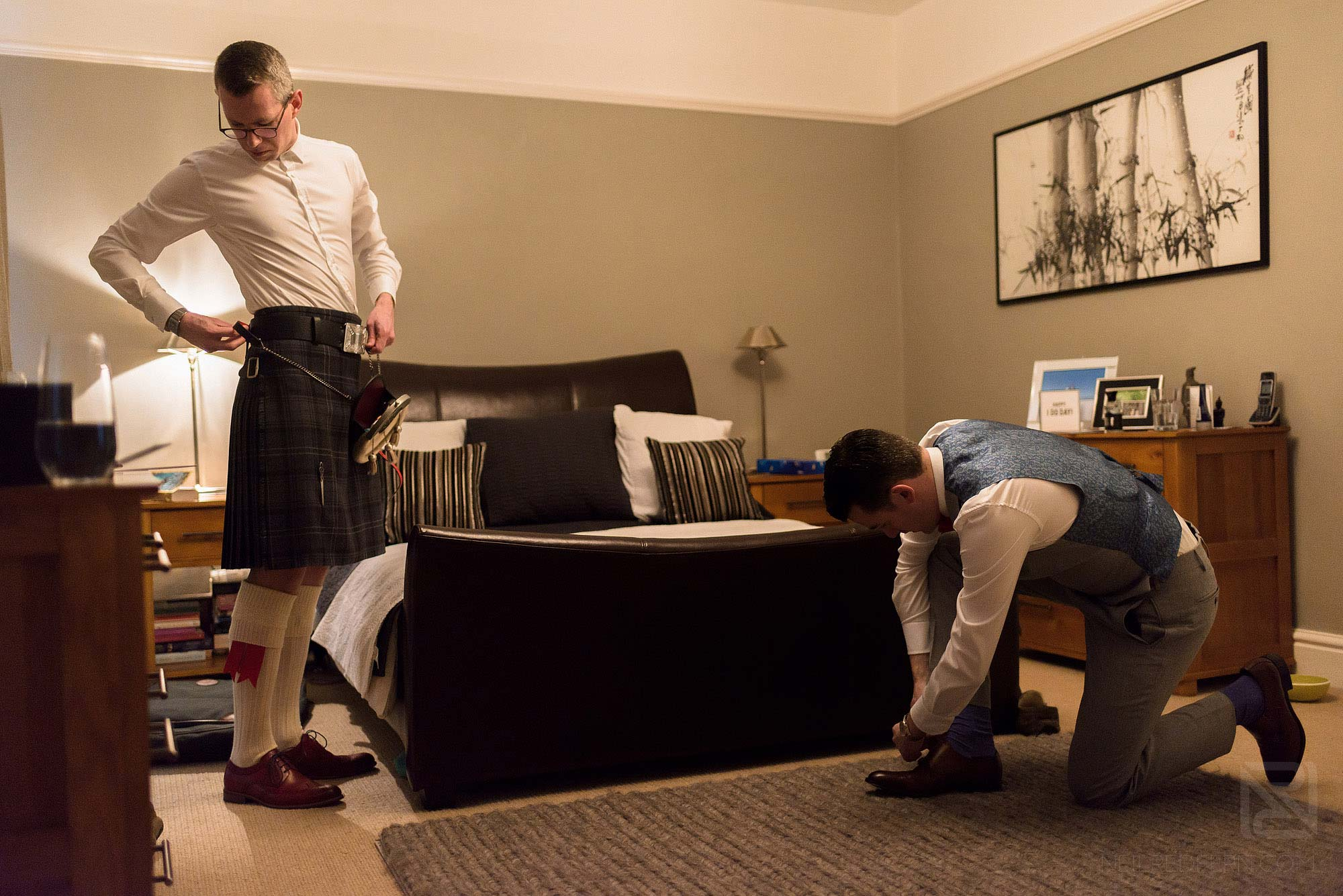 two grooms getting ready on morning of wedding