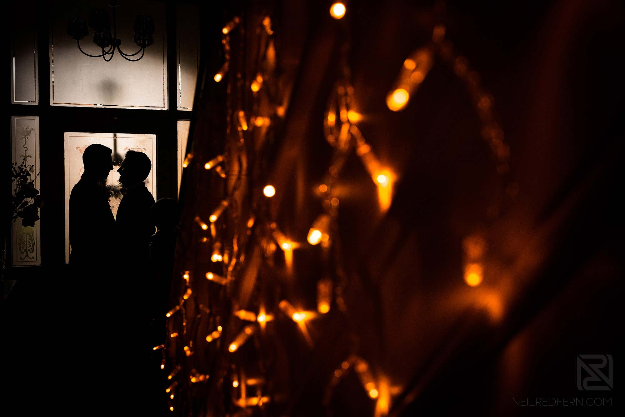 creative photograph of couple with fairylights on morning of wedding