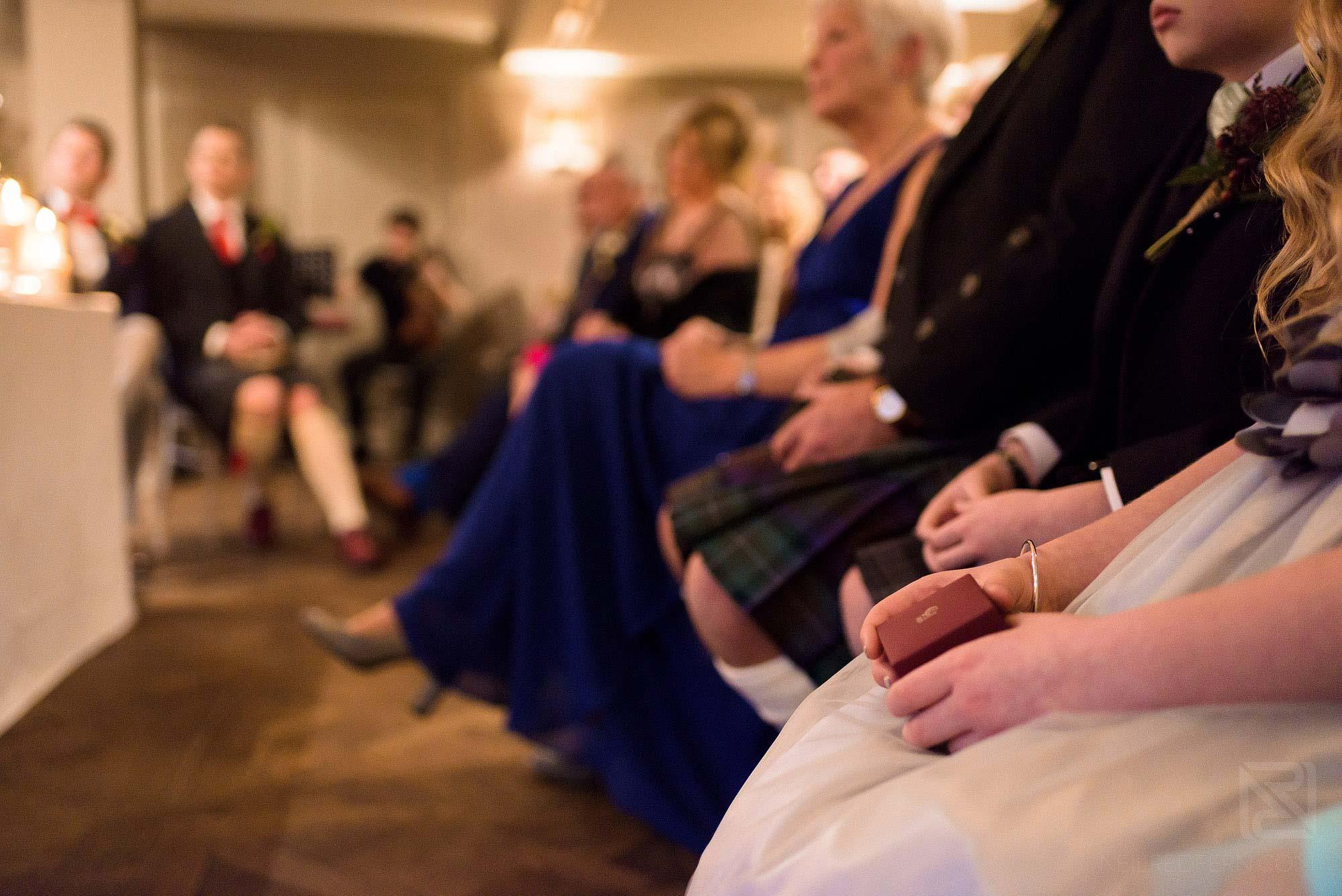 flower girl holding wedding rings during ceremony
