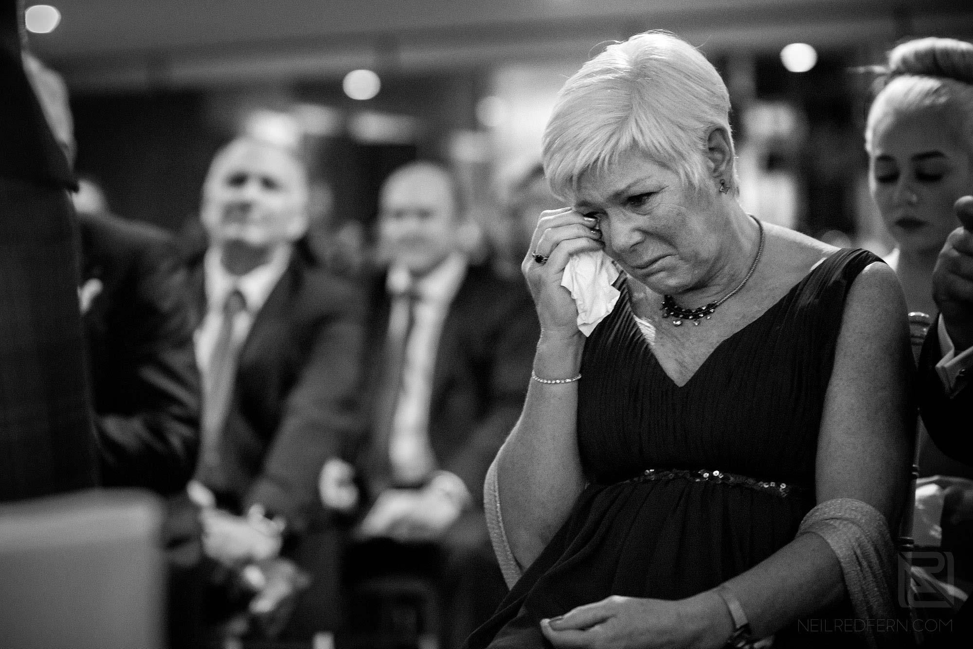 mother of groom crying during wedding ceremony
