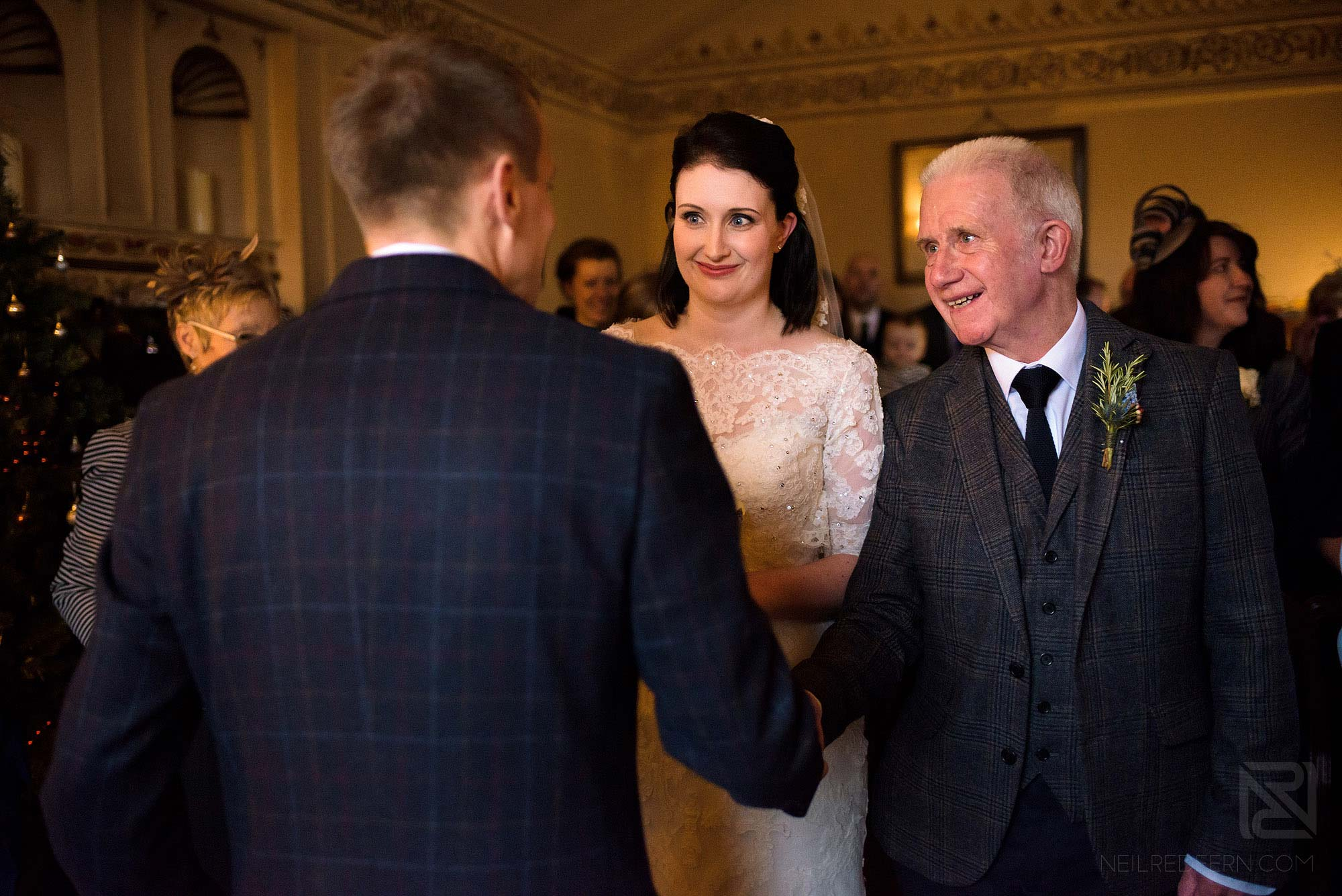 bride and father walking down aisle at Lake District winter wedding