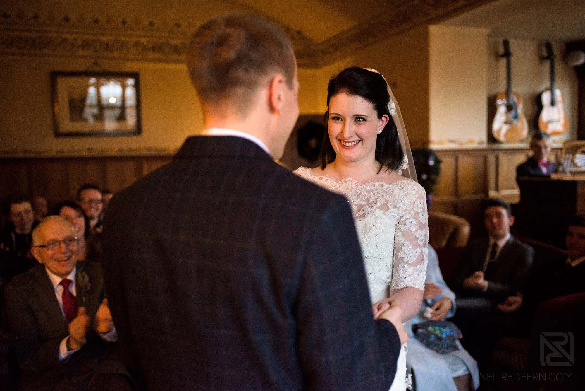bride smiling at groom during wedding ceremony in the Lake District