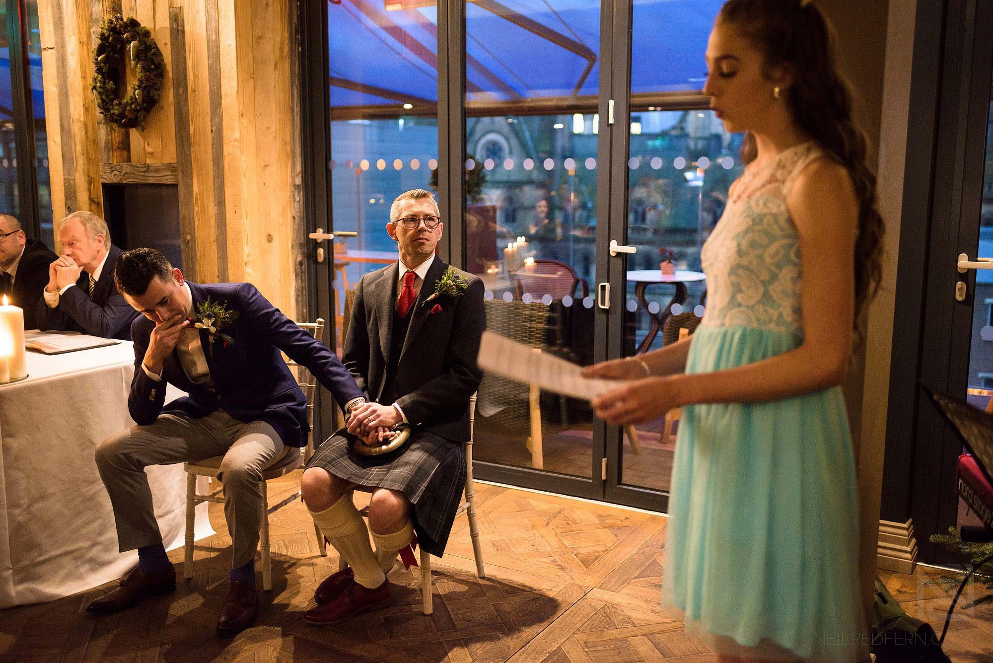 groom crying during wedding reading