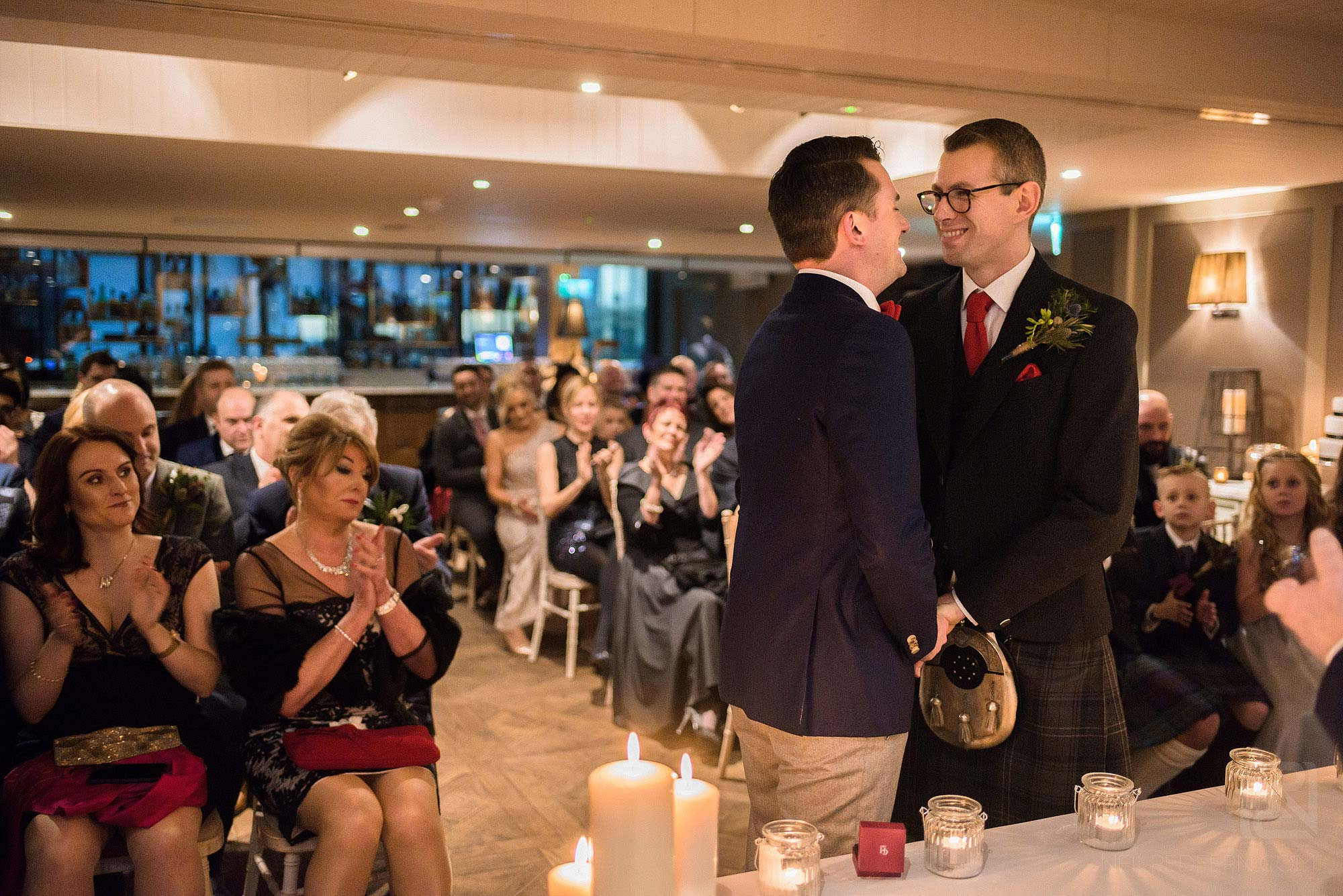 two grooms during wedding ceremony at King Street Townhouse