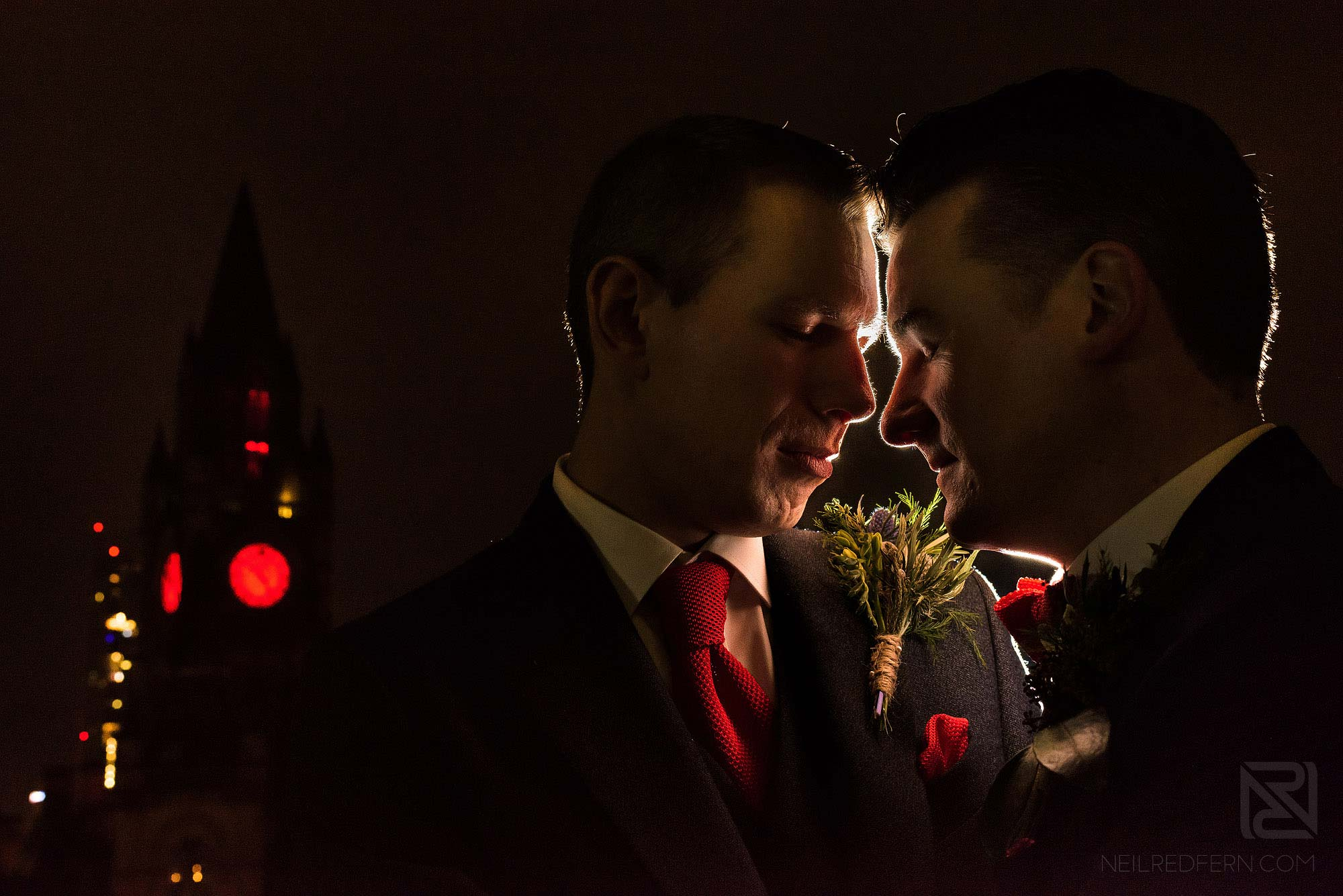 evening portrait of newlyweds on roof of King Street Townhouse with Manchester Town Hall in background