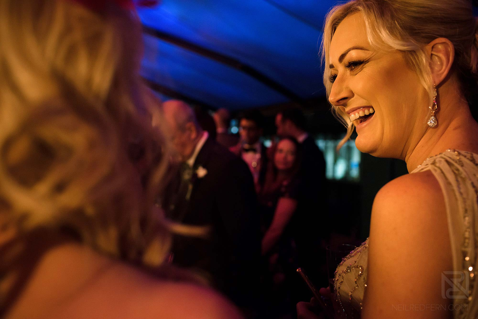 wedding guests laughing during drinks reception at King Street Townhouse wedding