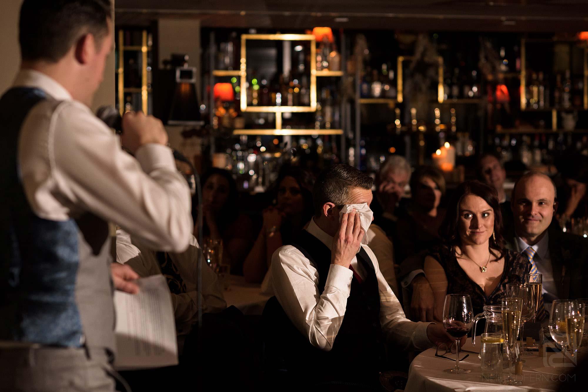 groom crying during wedding speech