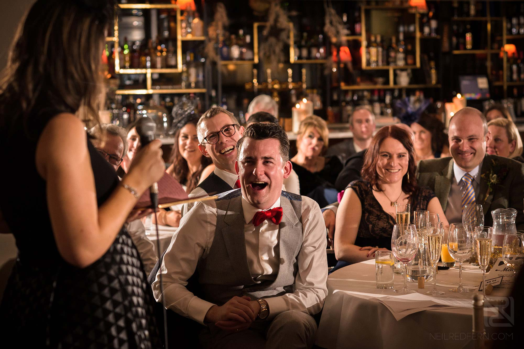 smiles and laughter during wedding speeches at King Street Townhouse in Manchester