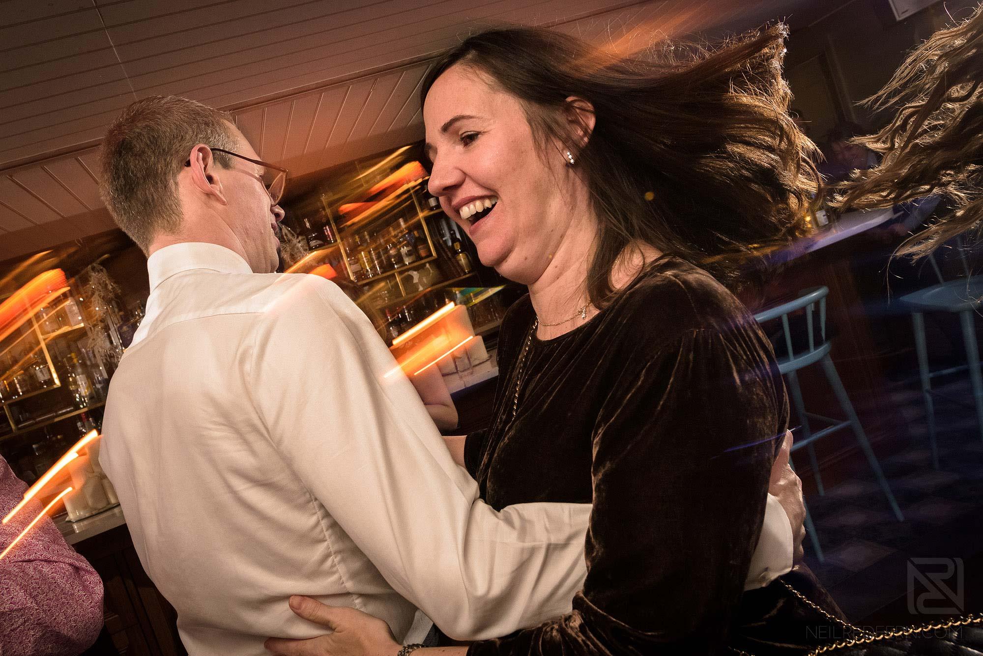 wedding guests dancing at wedding reception