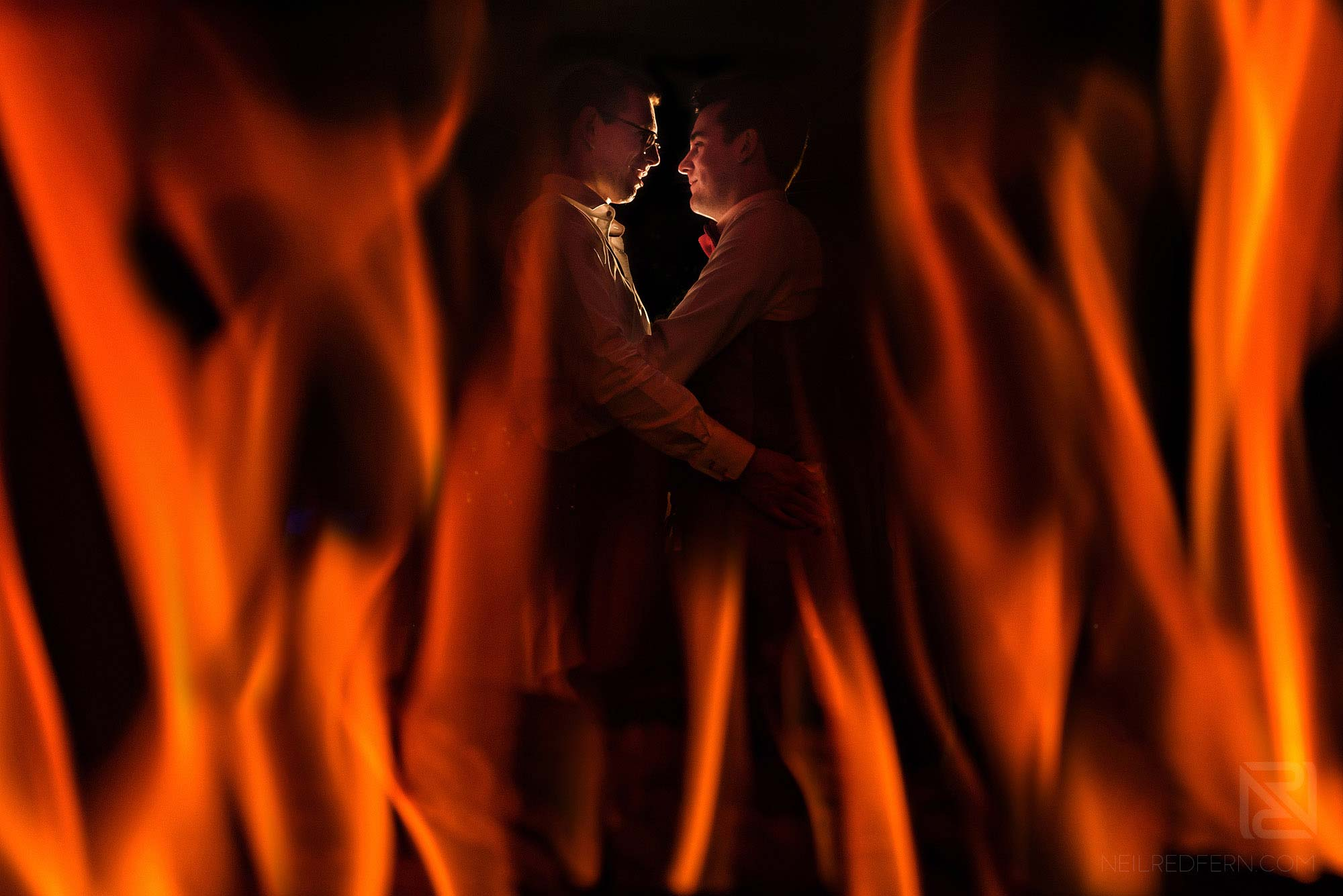 creative photograph of married couple with fire