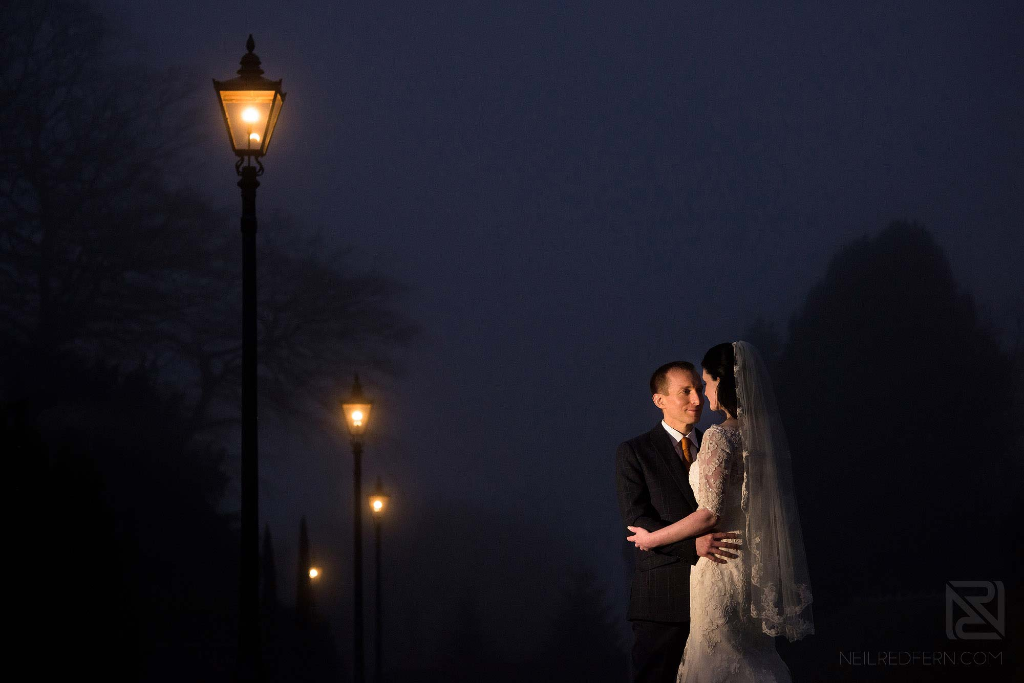 evening photograph of bride and groom outside Broadoaks Country House in Lake District
