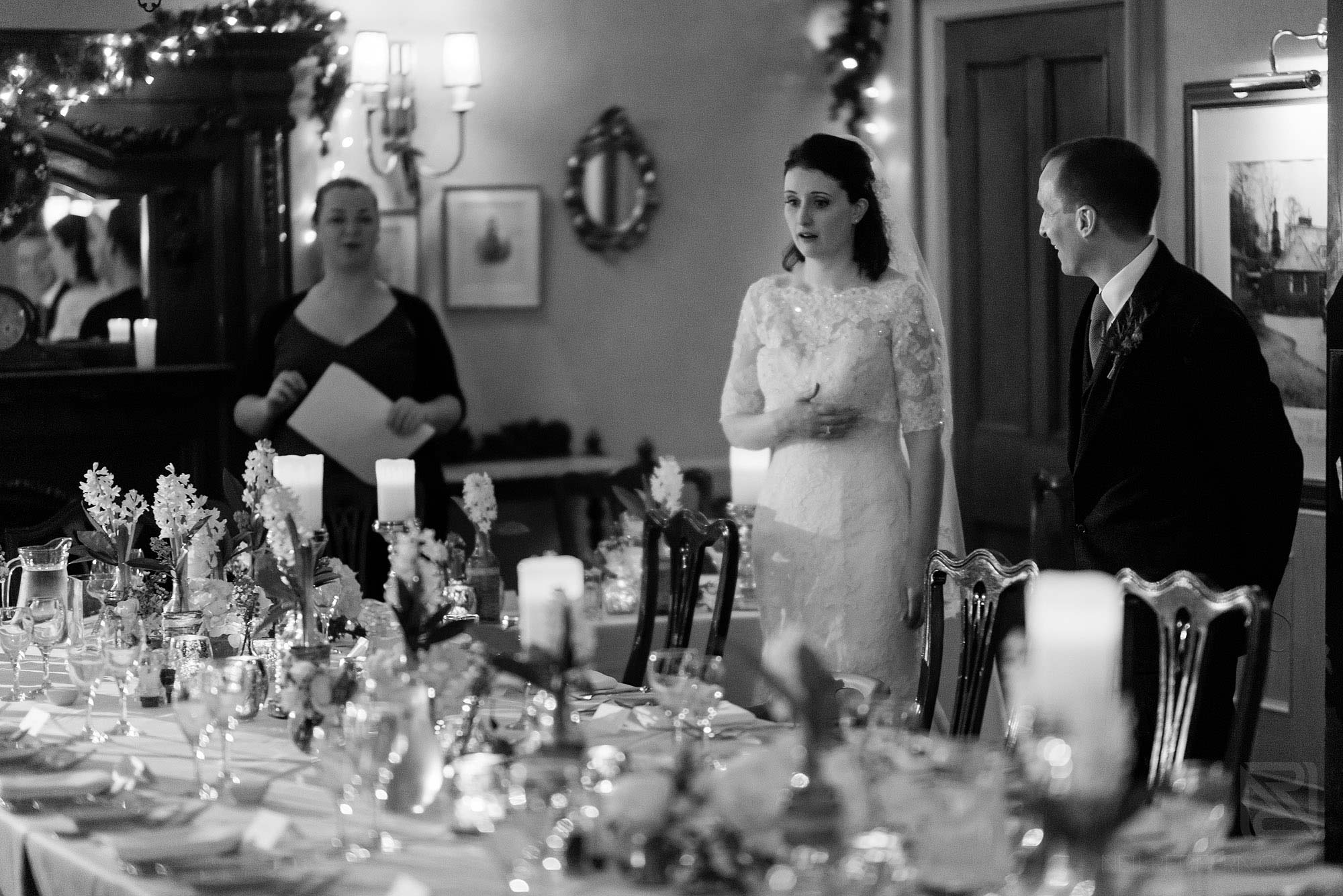bride looking shocked at wedding breakfast room at Broadoaks Country House