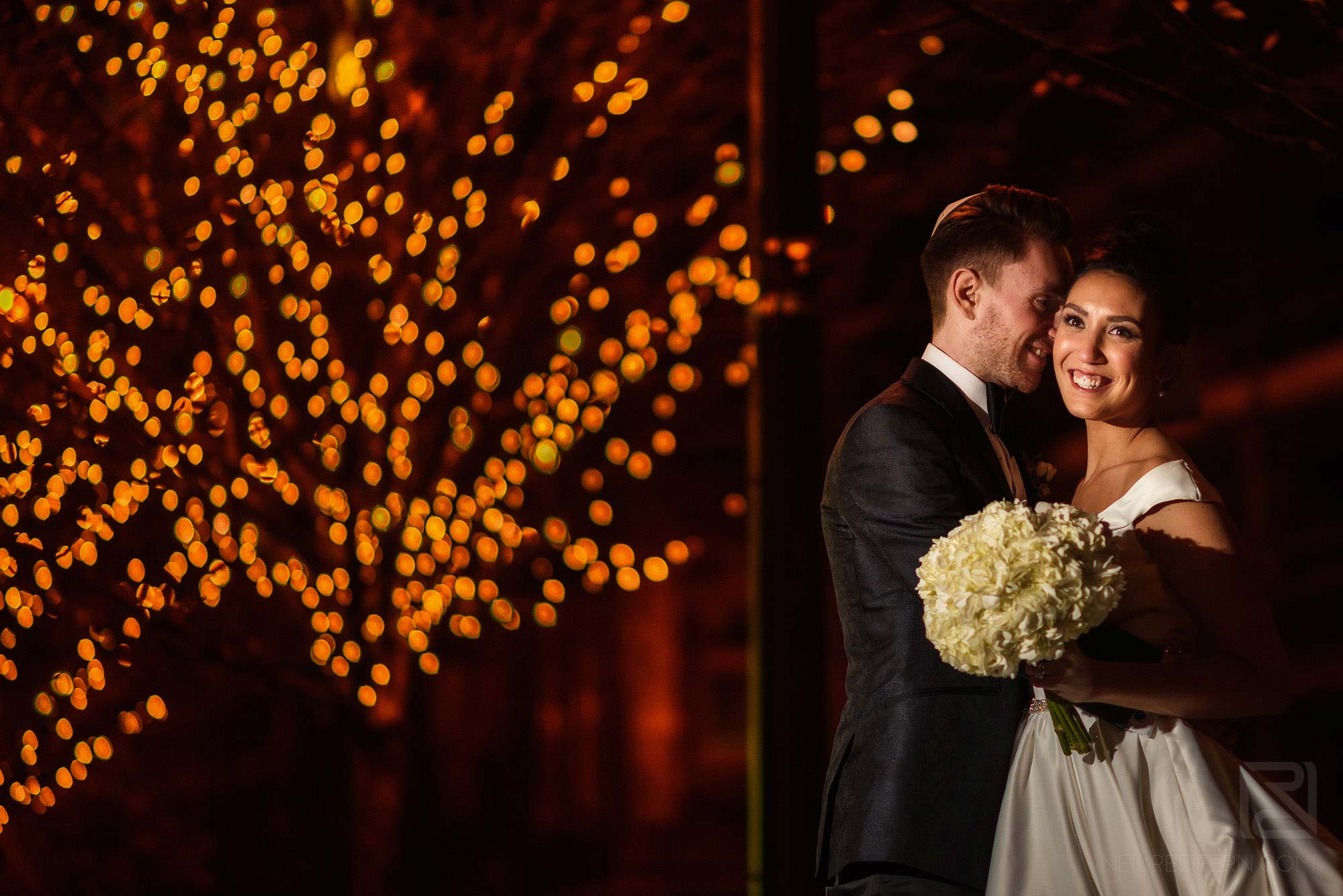 portrait of bride and groom outside at winter wedding in Manchester
