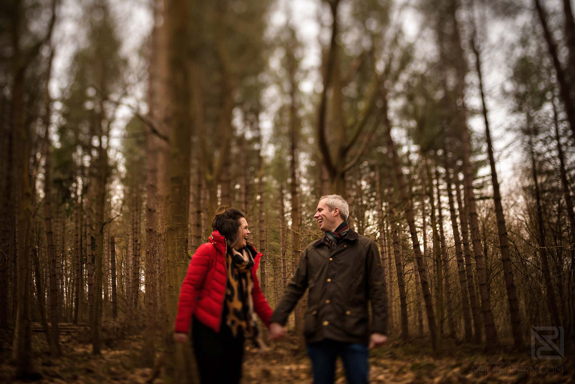couple laughing in Delamere Forest