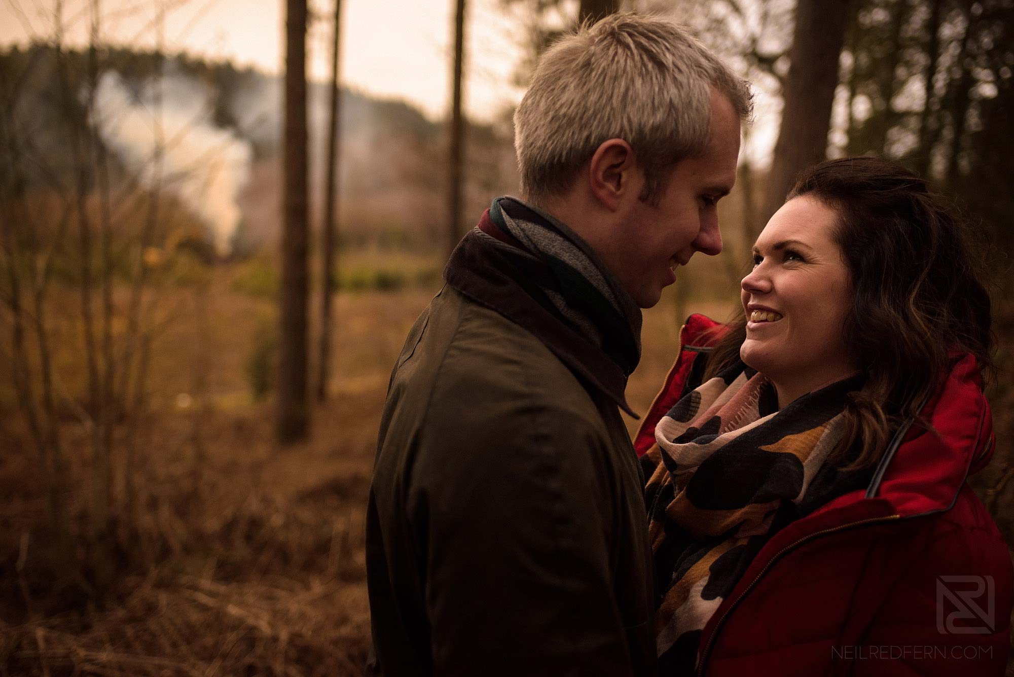 couple smiling in the forest
