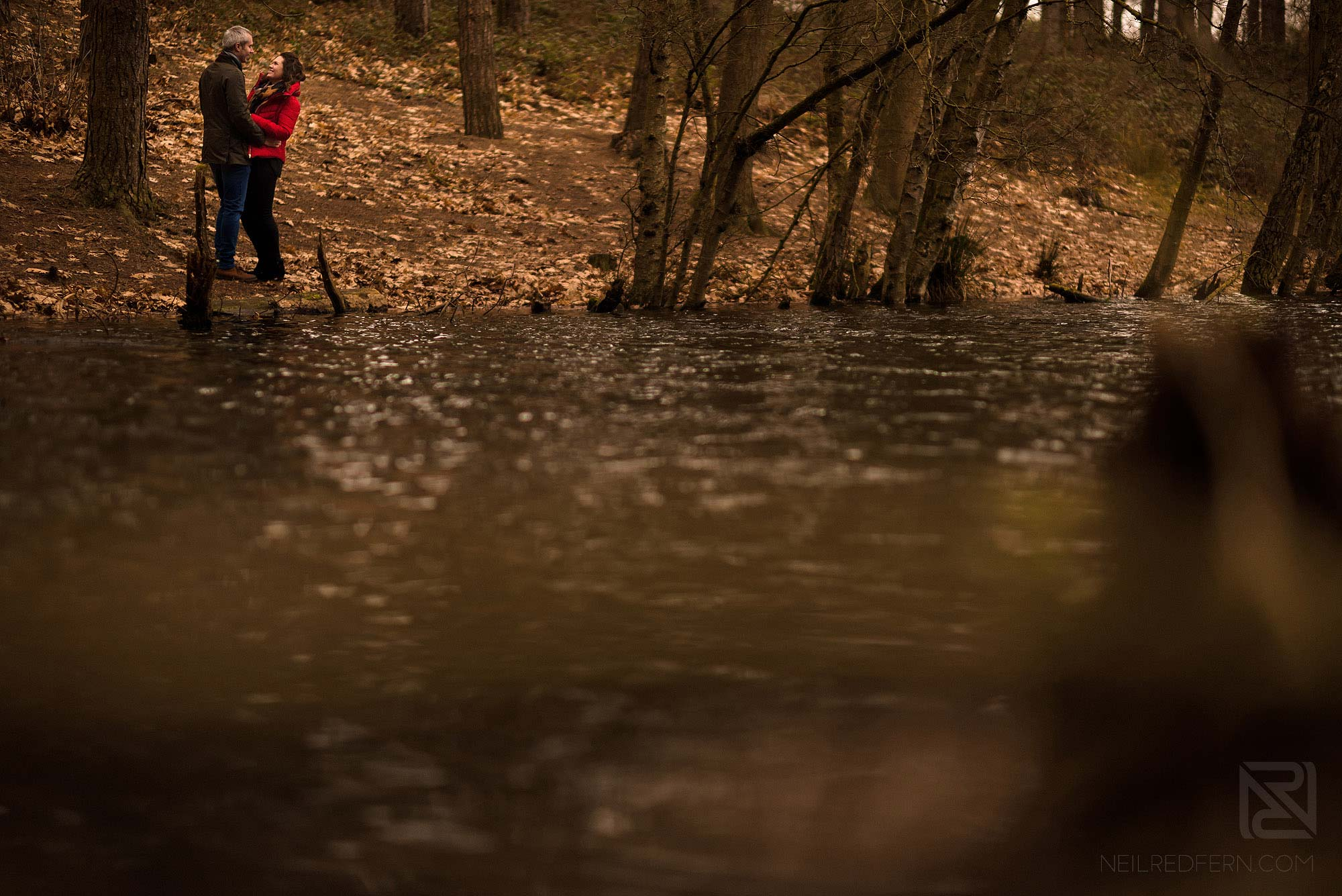 romantic photograph of engaged couple in Delamere Forest