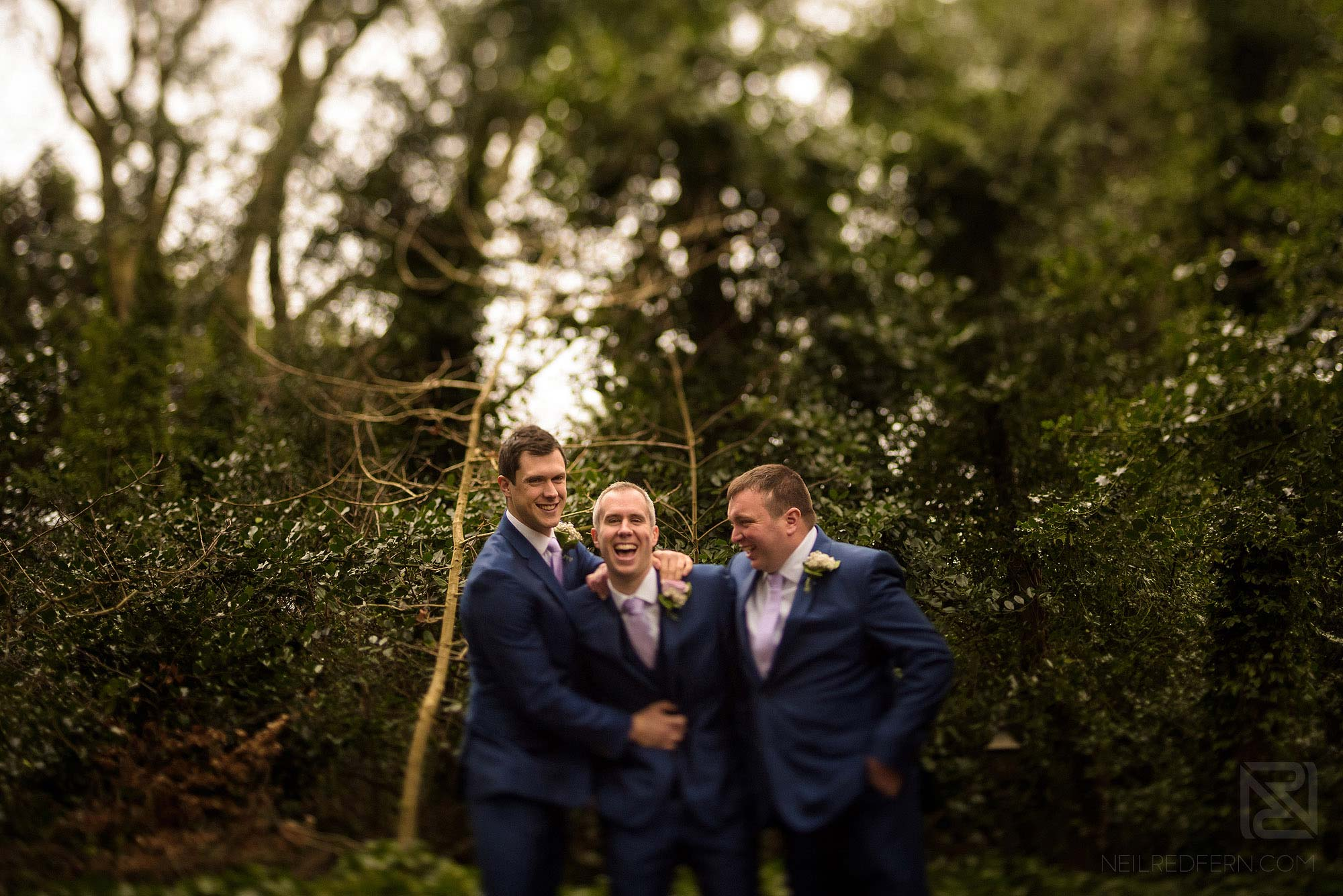 groom and best men laughing before wedding at Rowton Hall