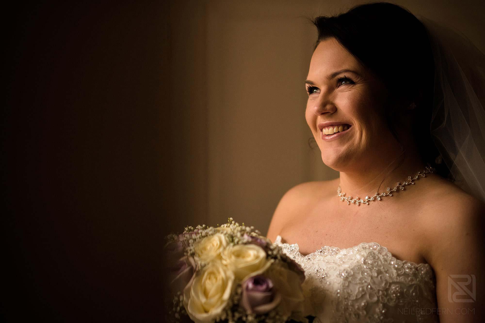 beautiful portrait of happy bride holding bouquet