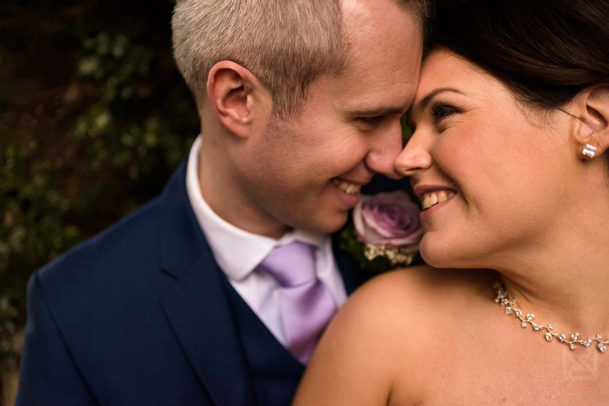 close up romantic photograph of bride and groom together at Rowton Hall