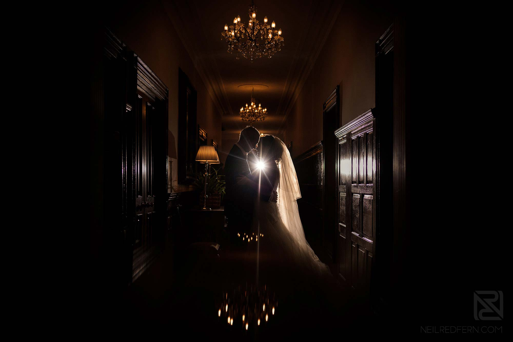 creative indoor photograph of bride and groom at Rowton Hall in Cheshire