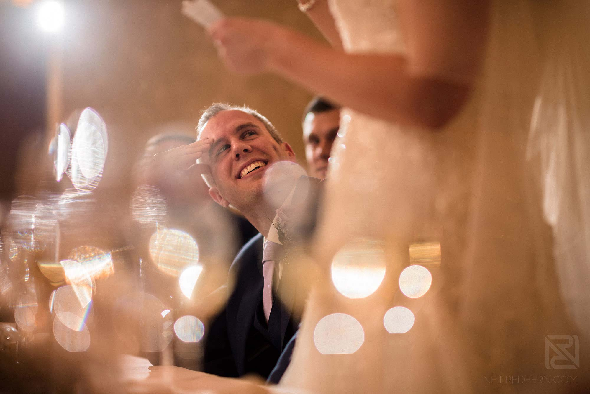 groom looking at wife during wedding speeches at Rowton Hall