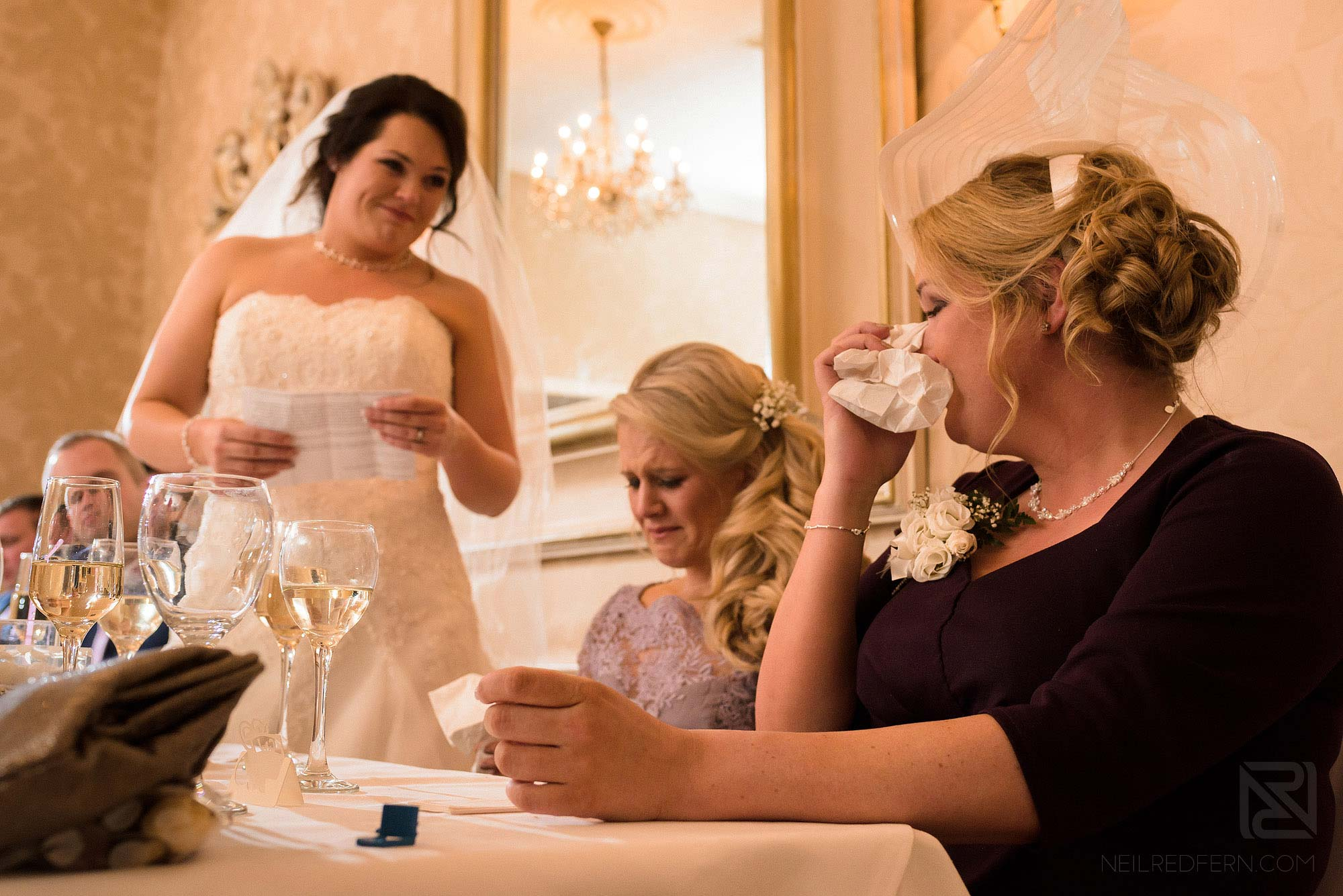 top table getting emotional during wedding speeches at Rowton Hall