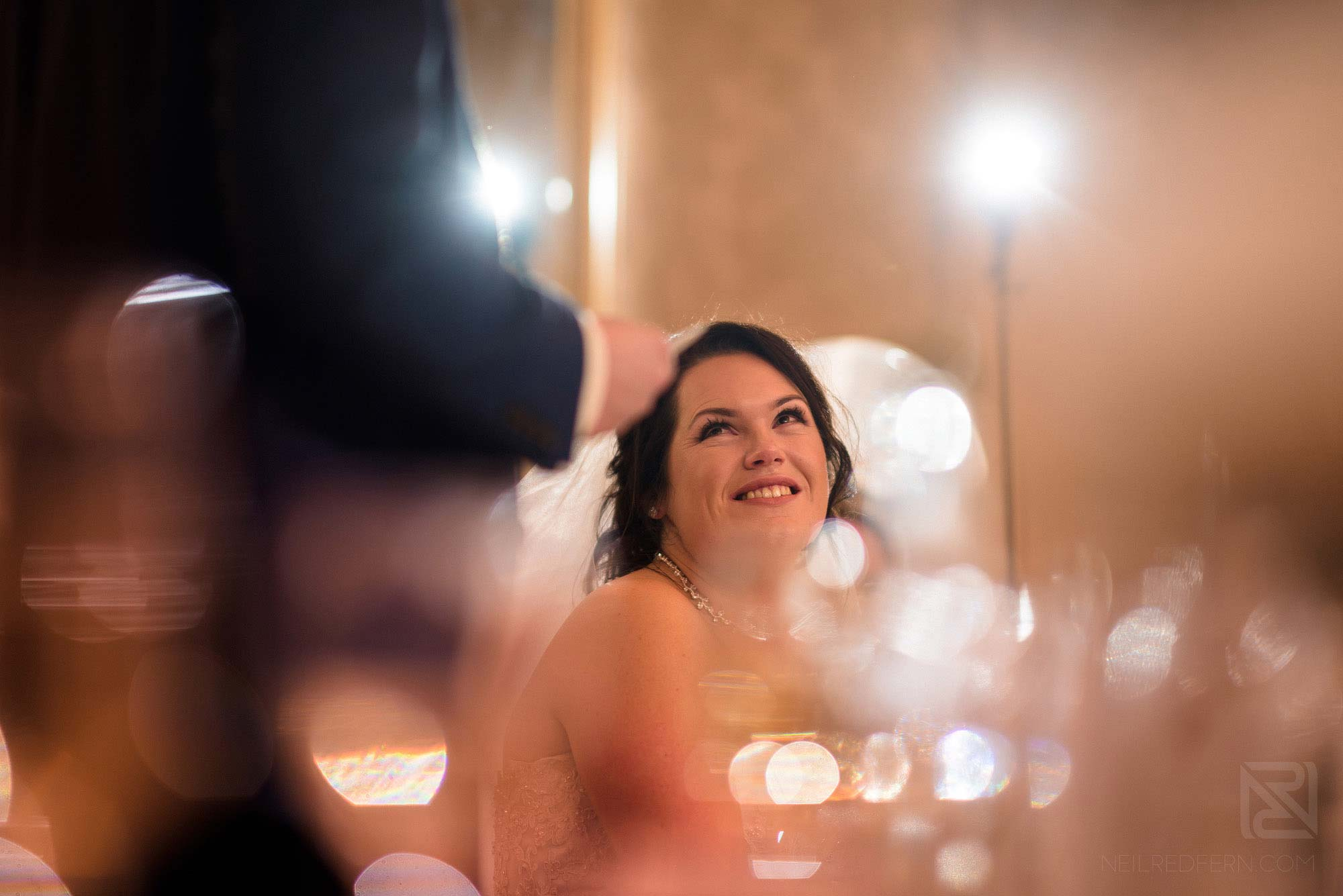 bride smiling and happy during wedding speeches