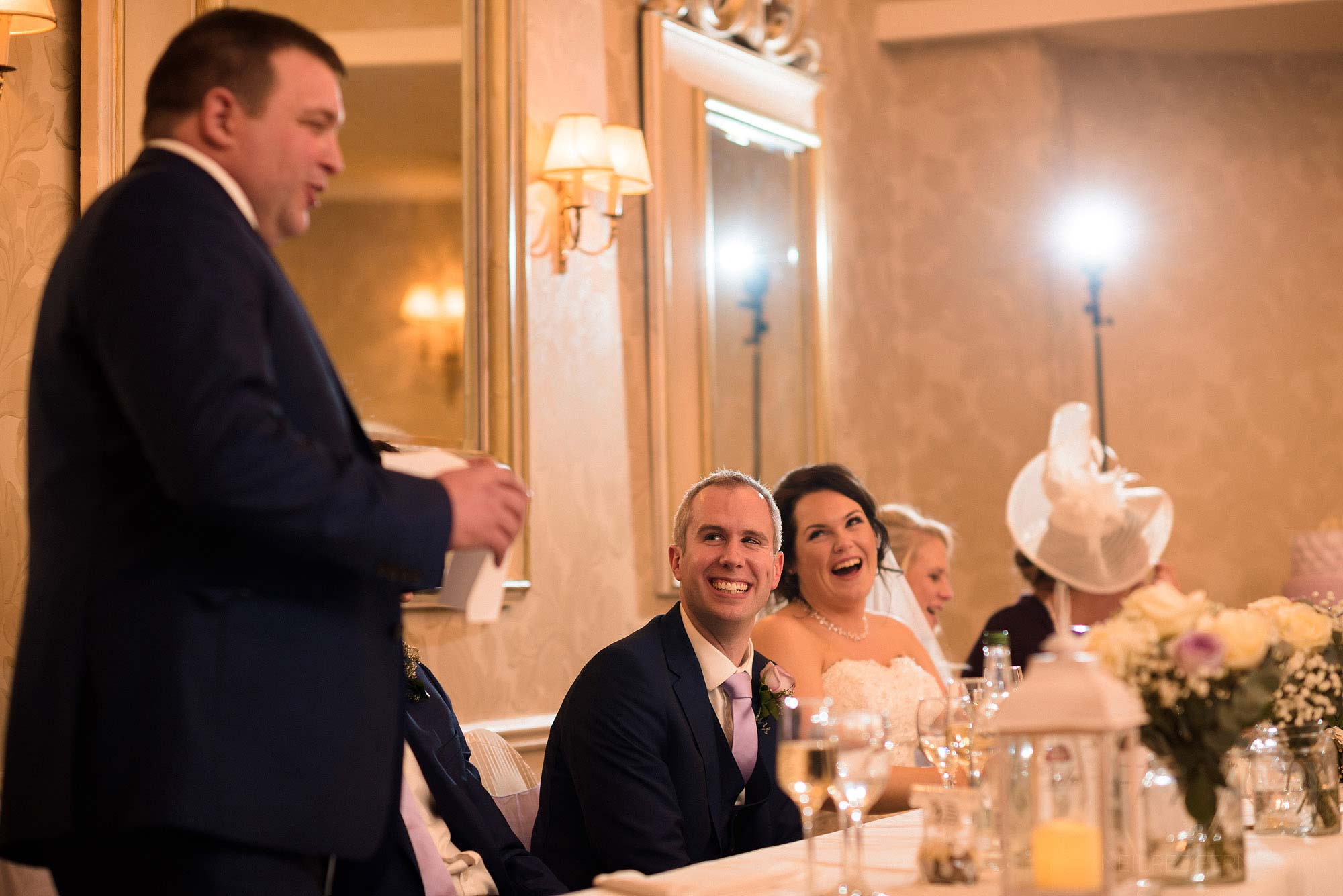 top table laughing and smiling during best man's speech