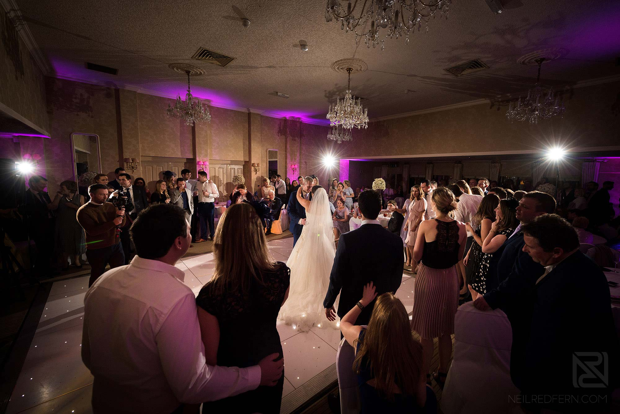 wide angle photograph of first dance at Rowton Hall wedding