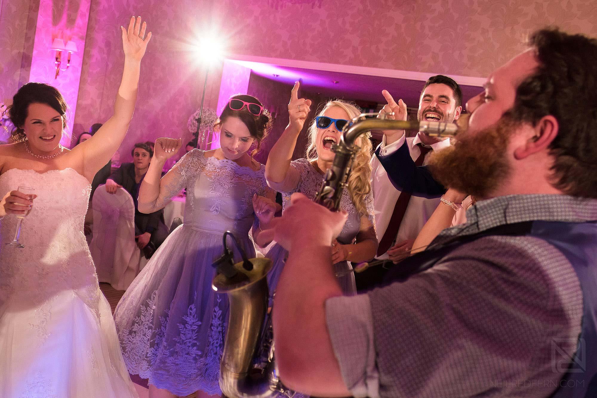 The Rush wedding band playing at Rowton Hall wedding