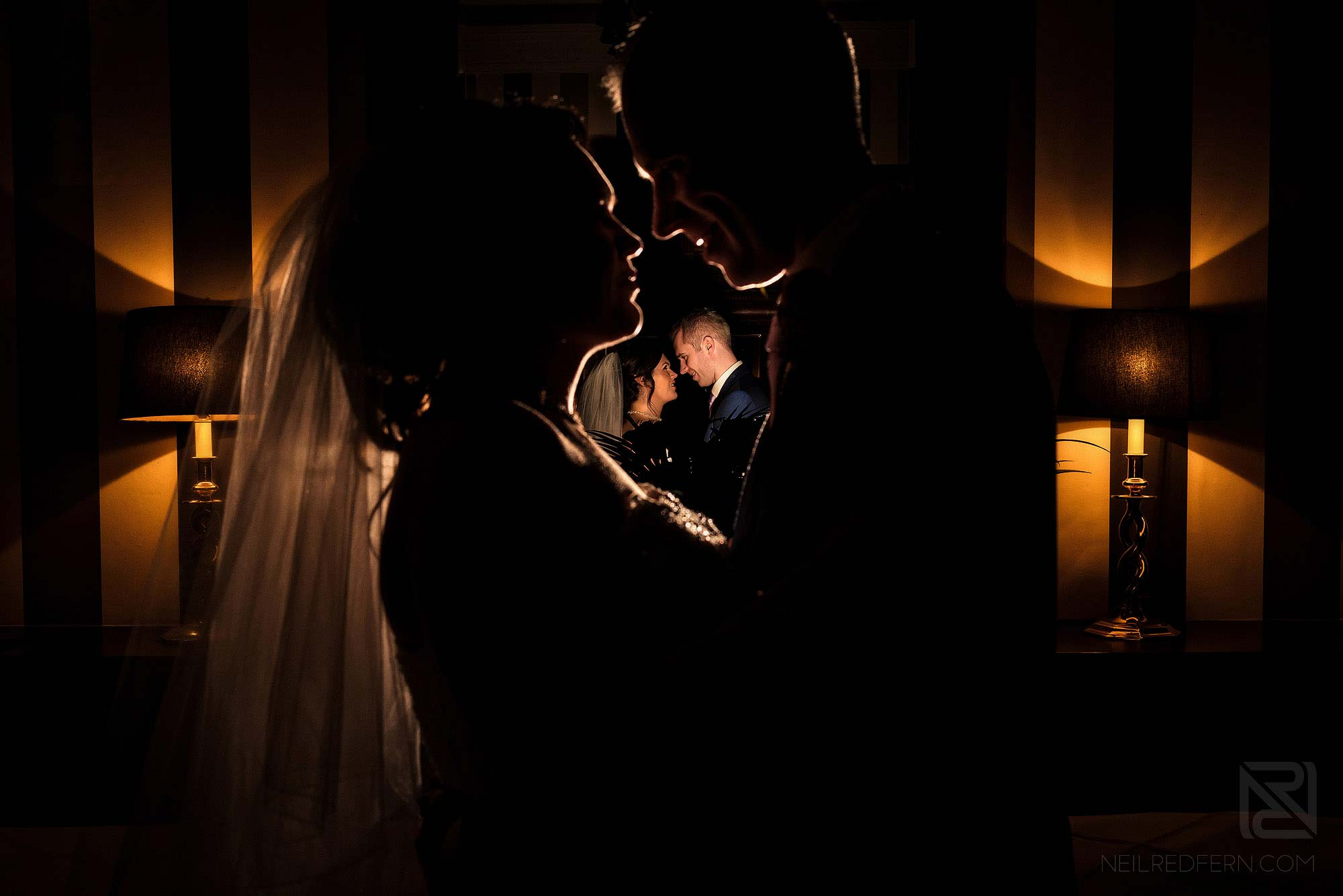 creative flash portrait of bride and groom indoors at Rowton Hall