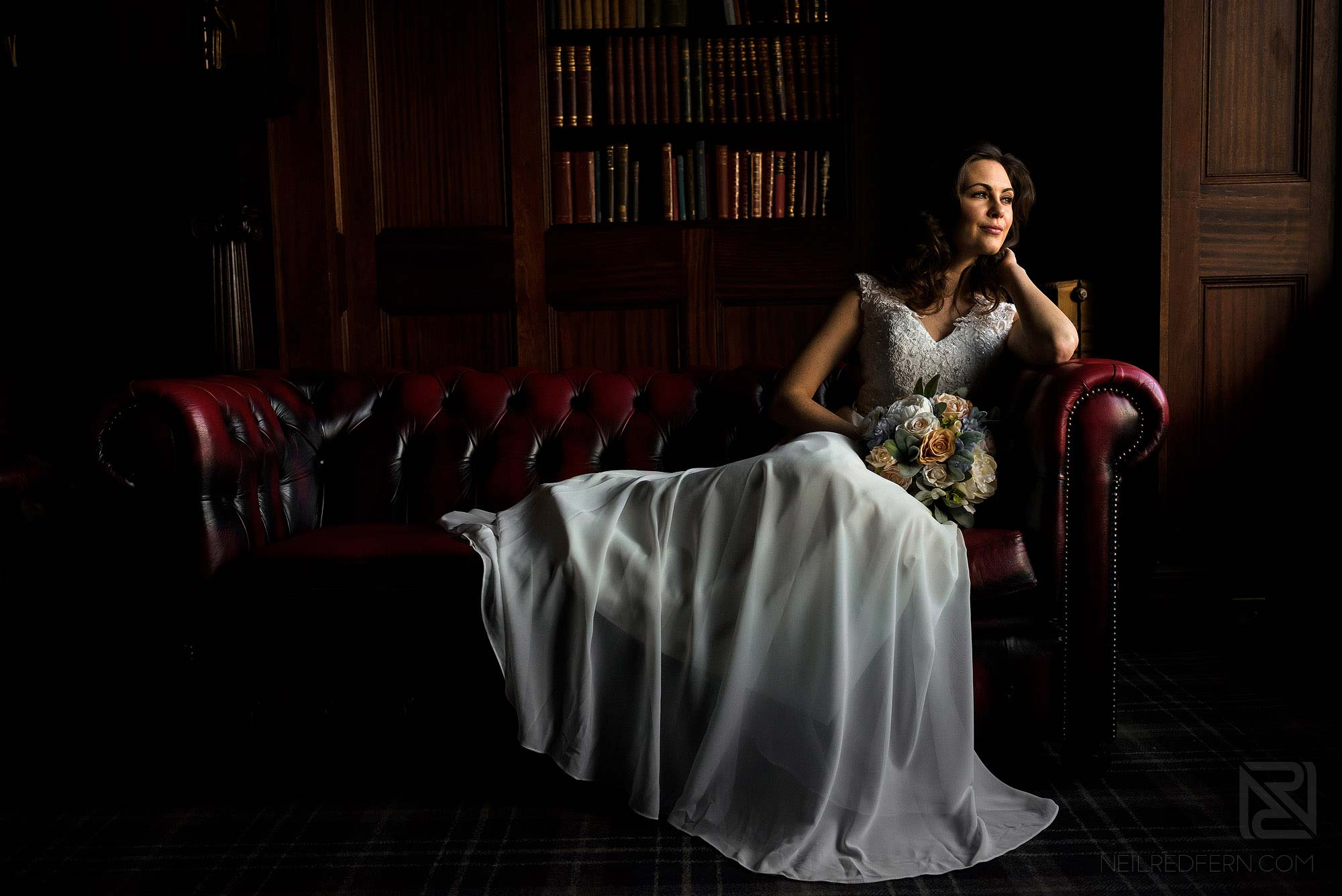 beautiful photograph of bride on sofa looking out of the window