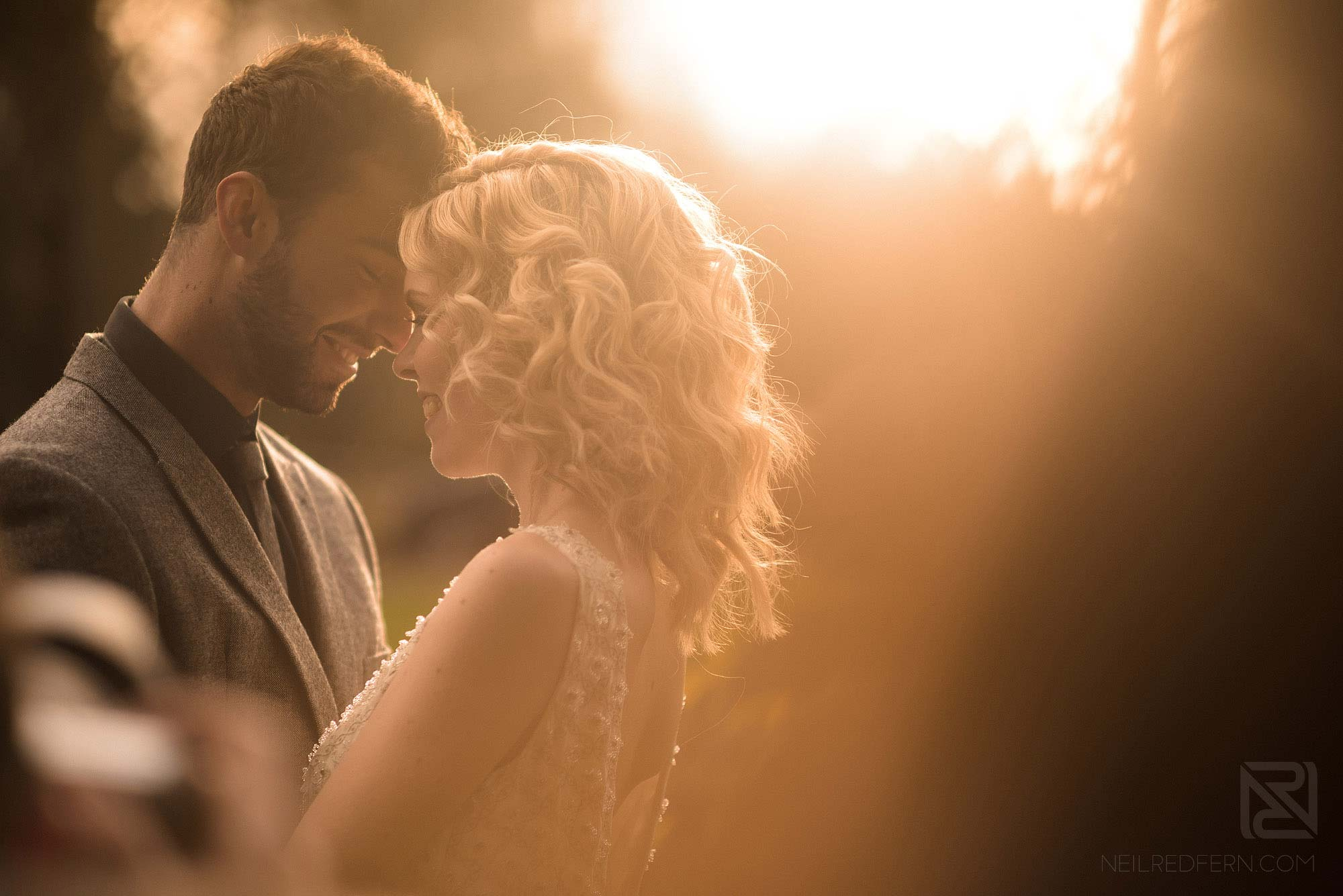 photograph of bride and groom at sunset