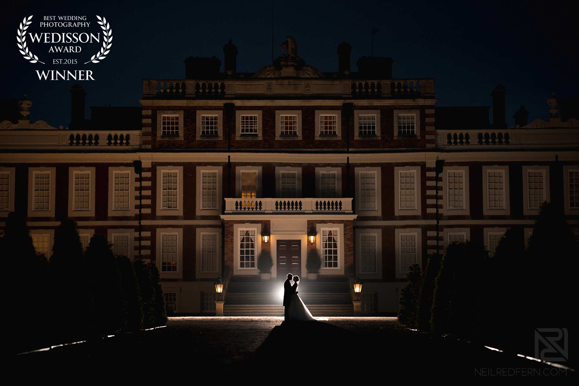 award winning wedding photograph of bride and groom outside Knowsley Hall