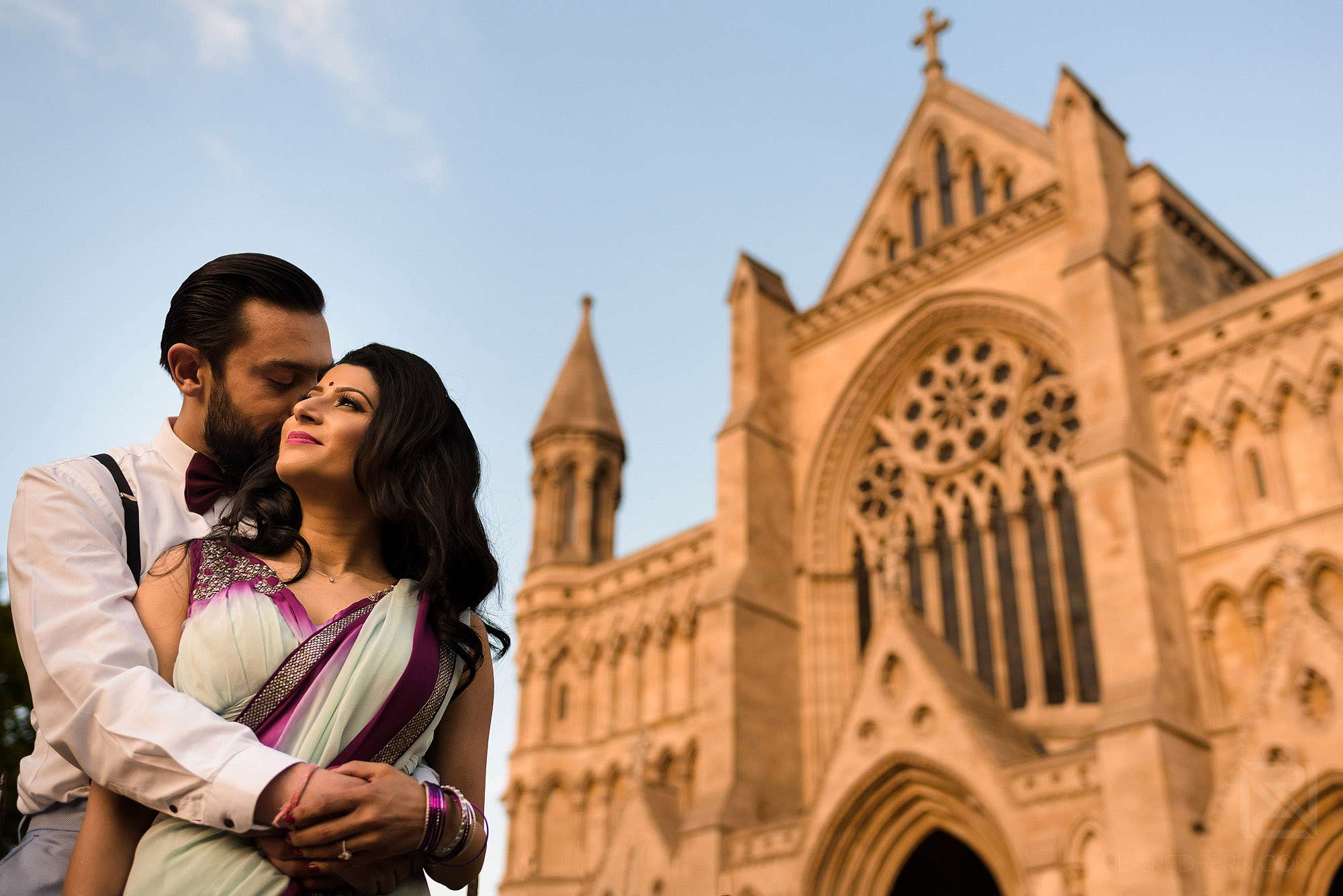 Hindu bride and groom outside St Albans Cathedral