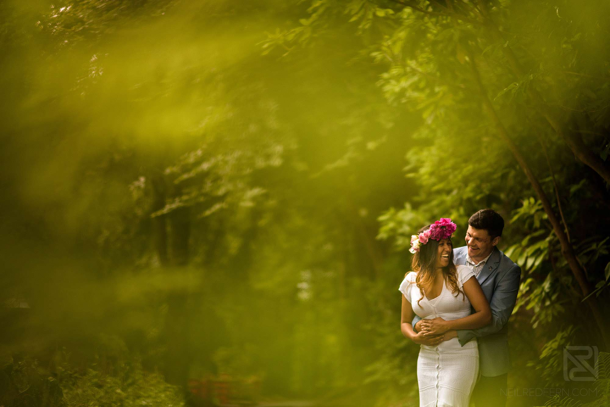bride and groom laughing on engagement shoot