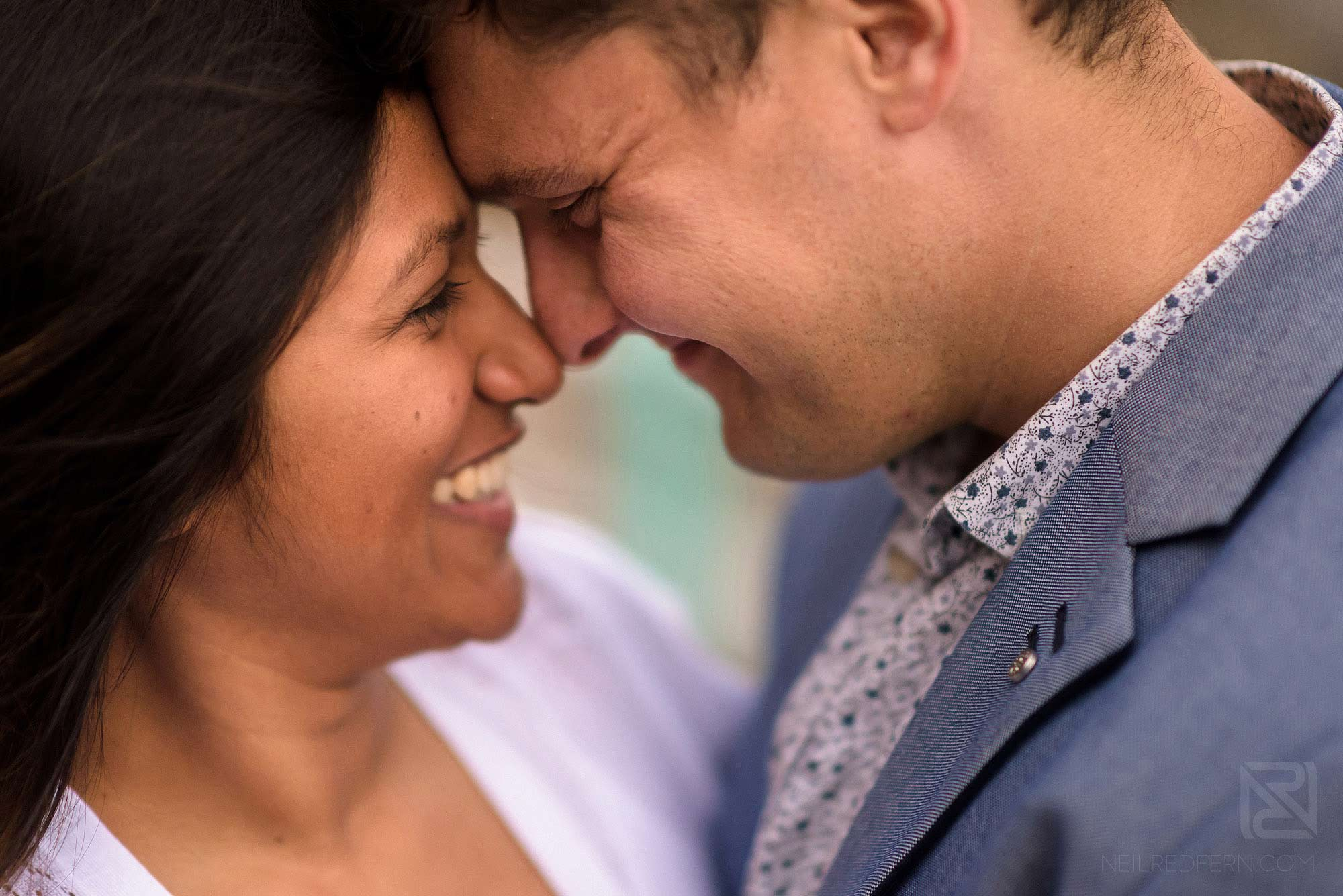 close up of smiling bride and groom on engagement shoot