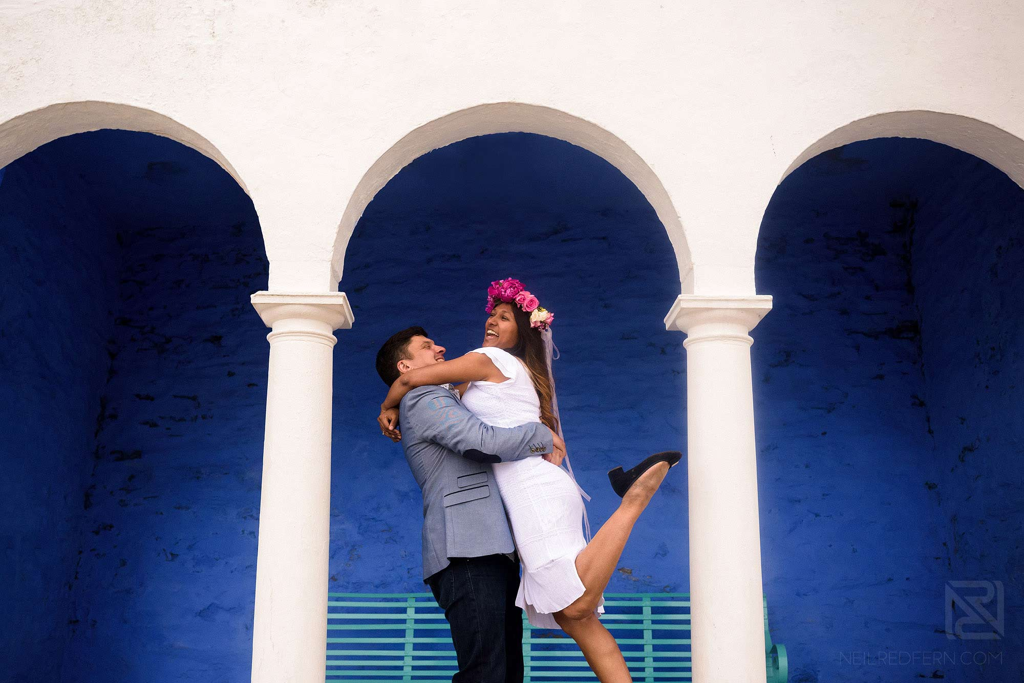 groom lifting up bride in Portmeirion