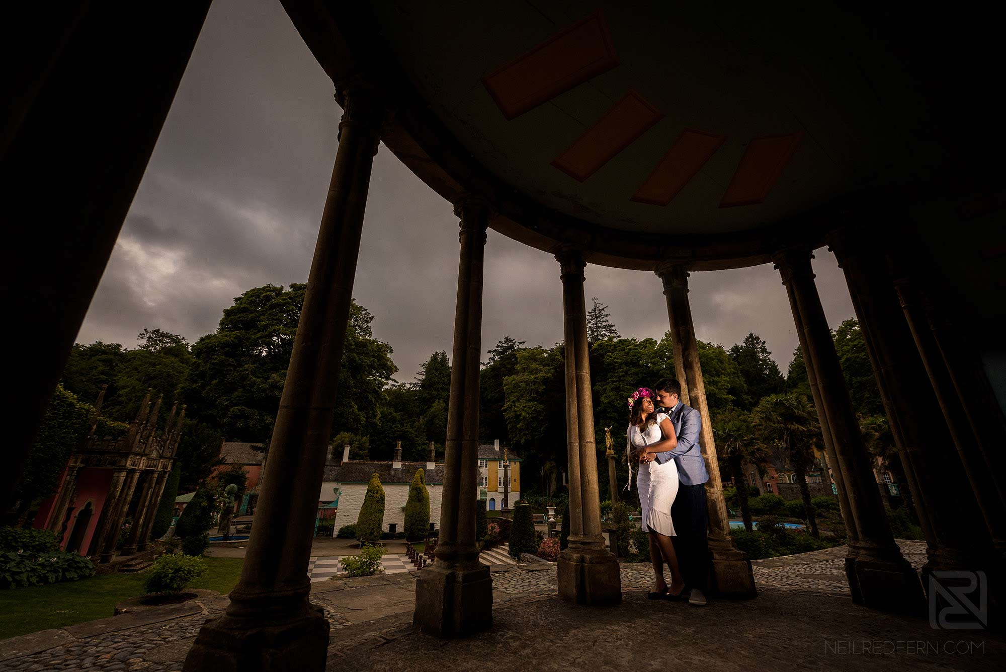creative off camera flash portrait of couple on engagement shoot