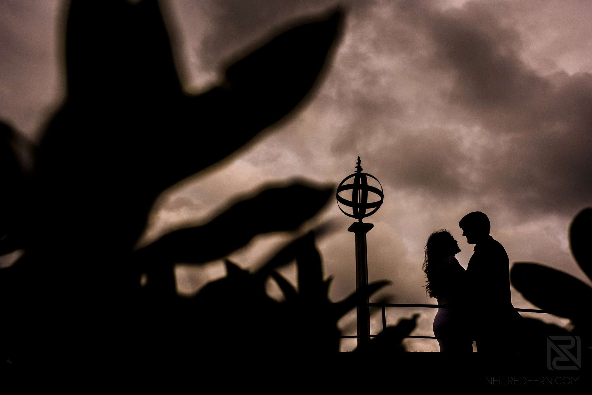 silhouette photograph of couple on engagement shoot