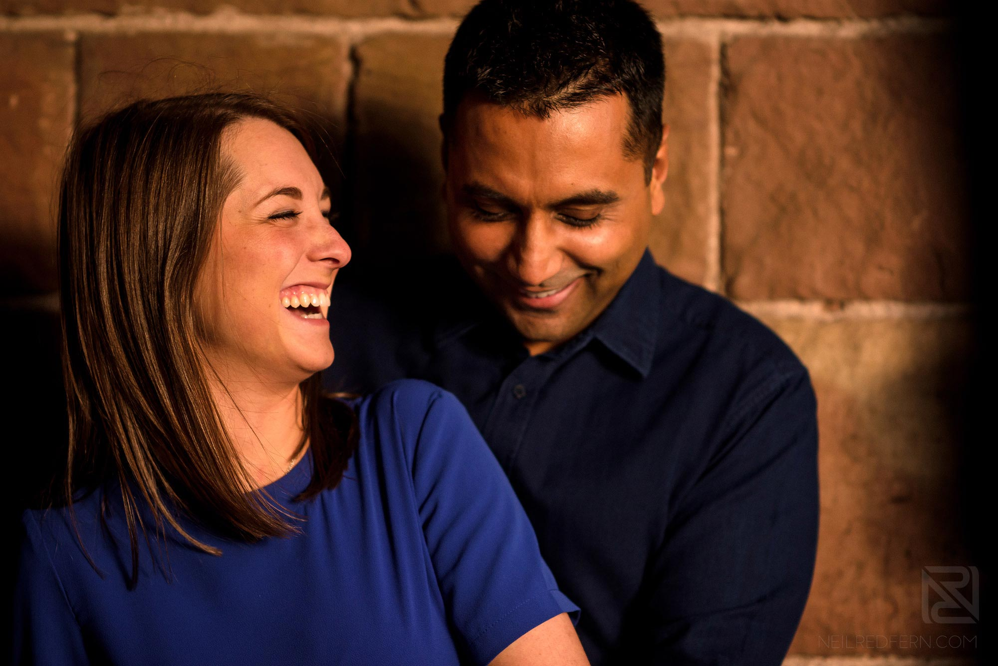 couple laughing on engagement shoot
