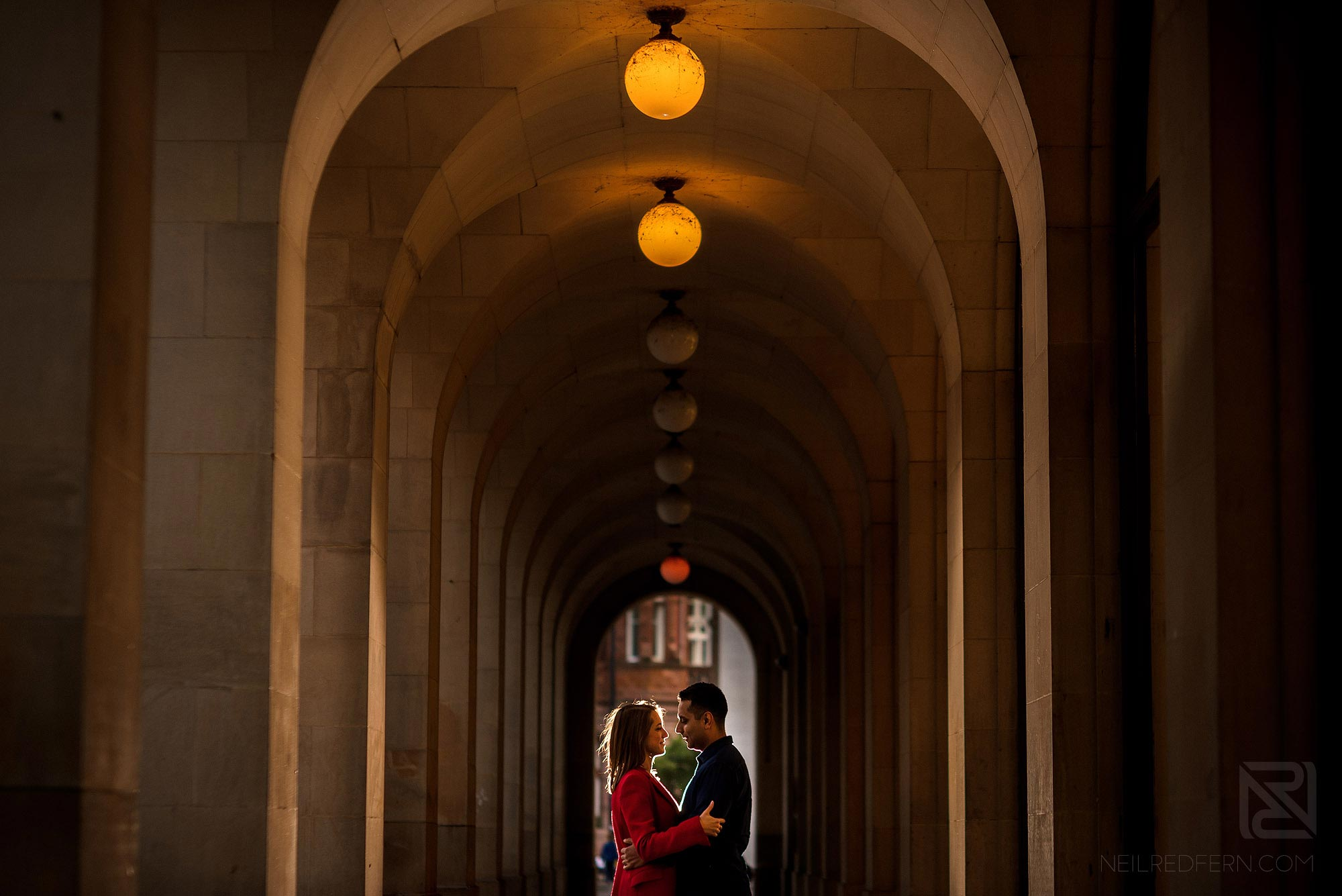 couple underneath arches in St Peter's Square in Manchester